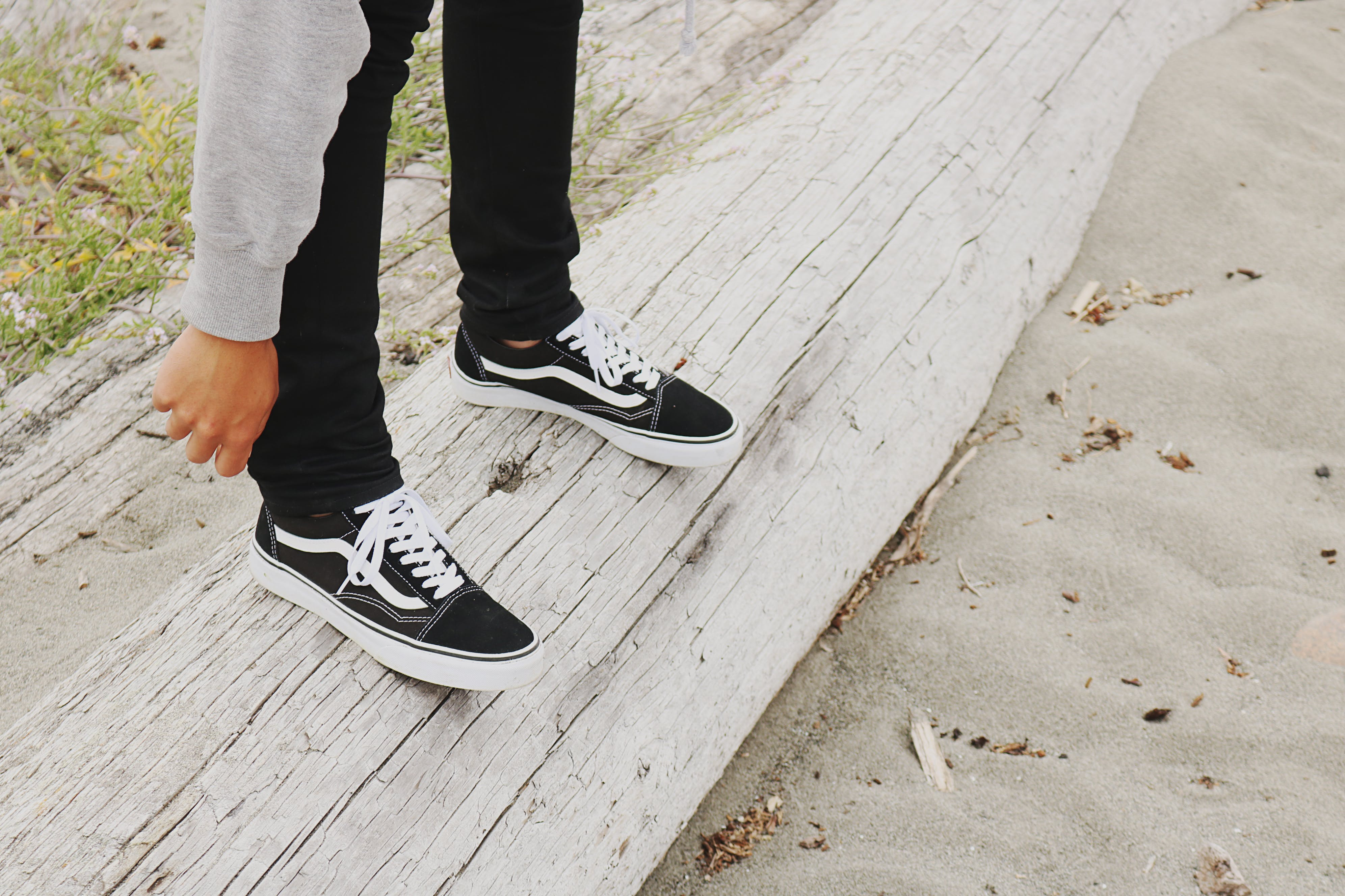 Person Wearing Black Vans Low-top Sneakers