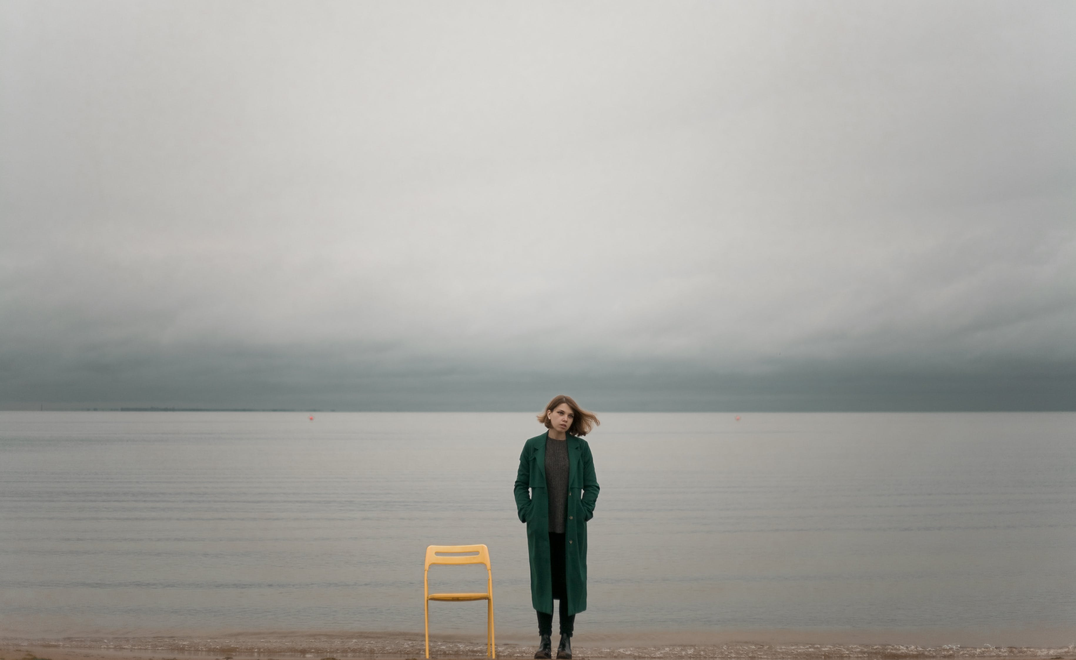 Woman Standing Beside Chair