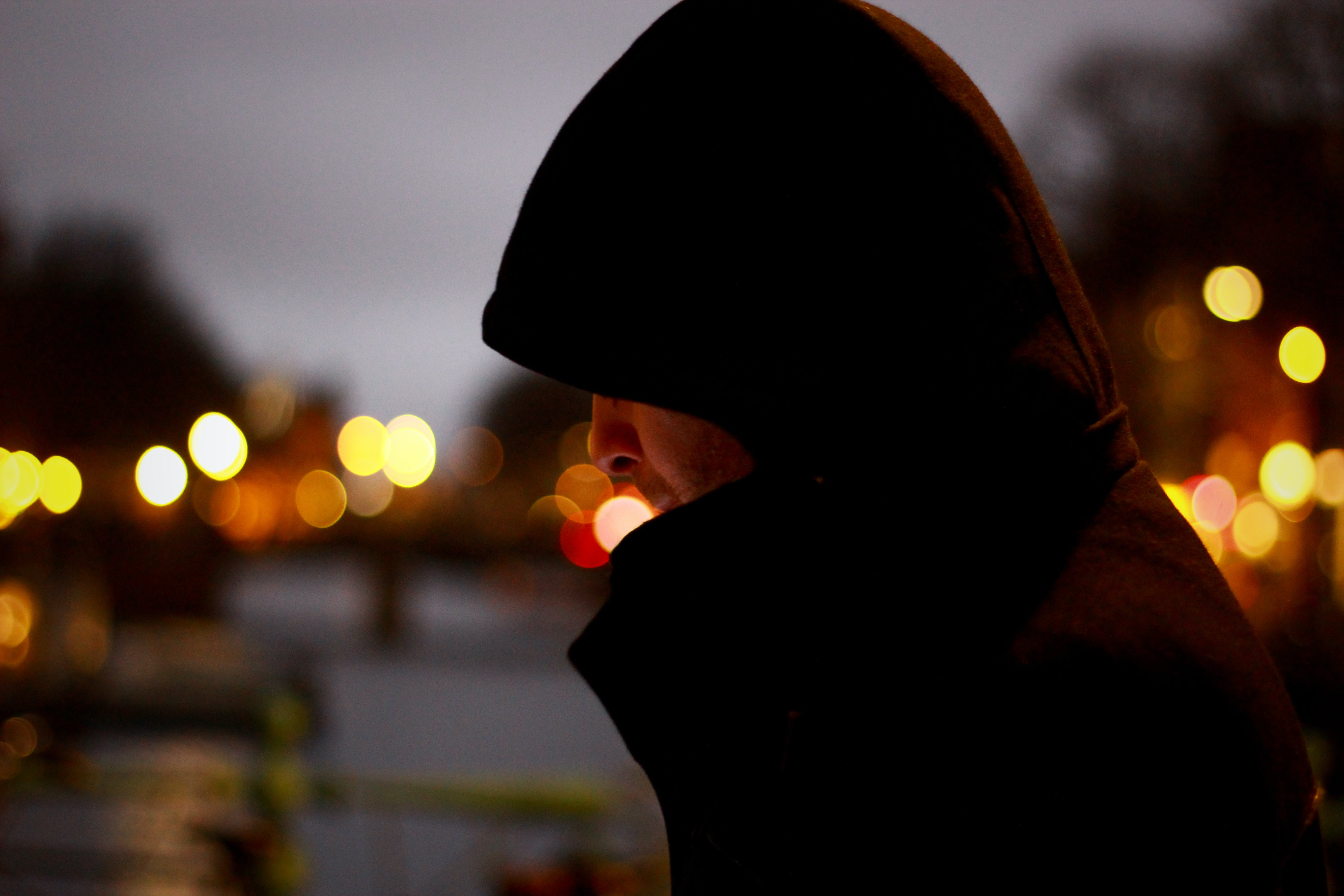 Close Up Photo of Person Wearing Hoodie
