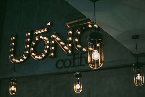 Photo of Uonc Coffee Marquee Lights Near Pendant Lamps