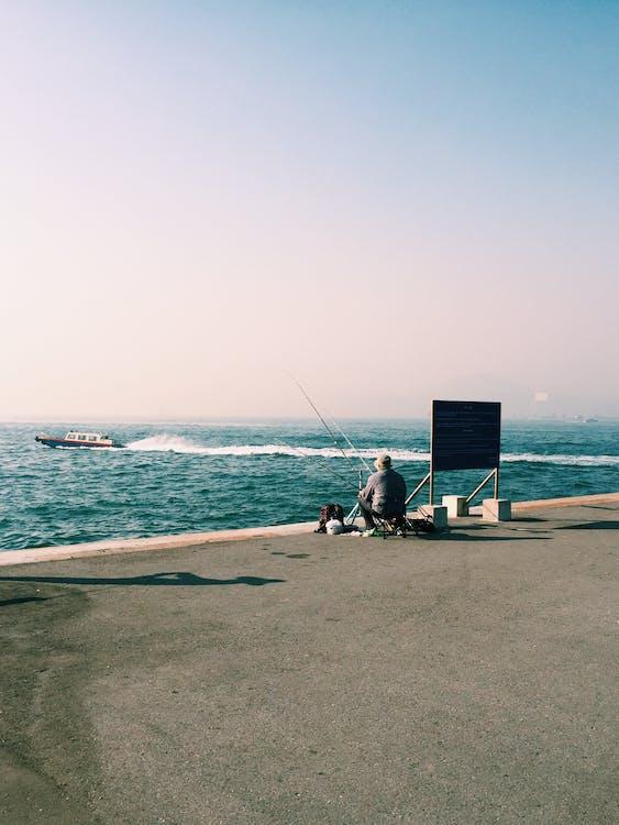 Základová fotografie zdarma na téma člun, moře, muž