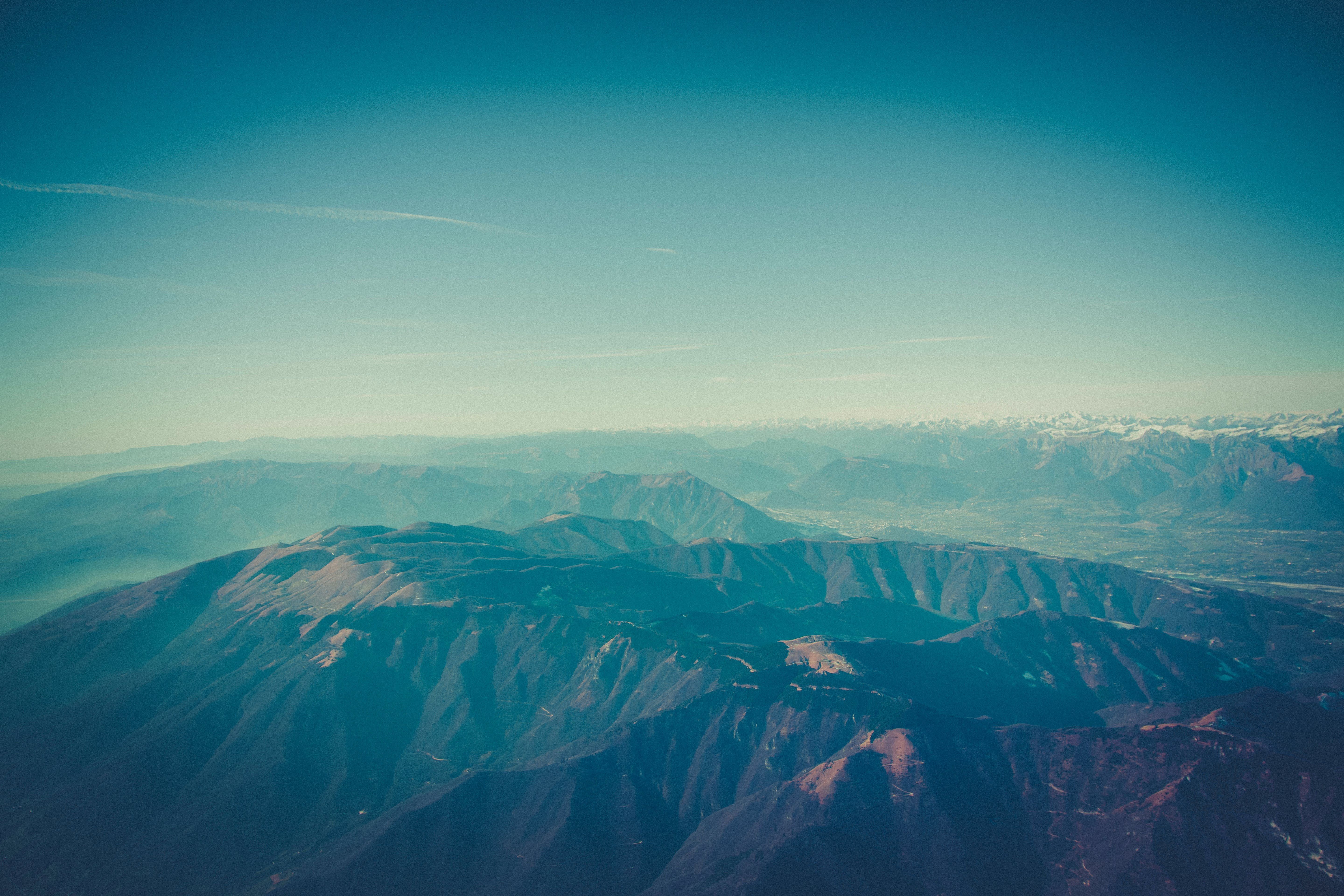 Aerial Photography of Mountain Under Sunny Blue Sky