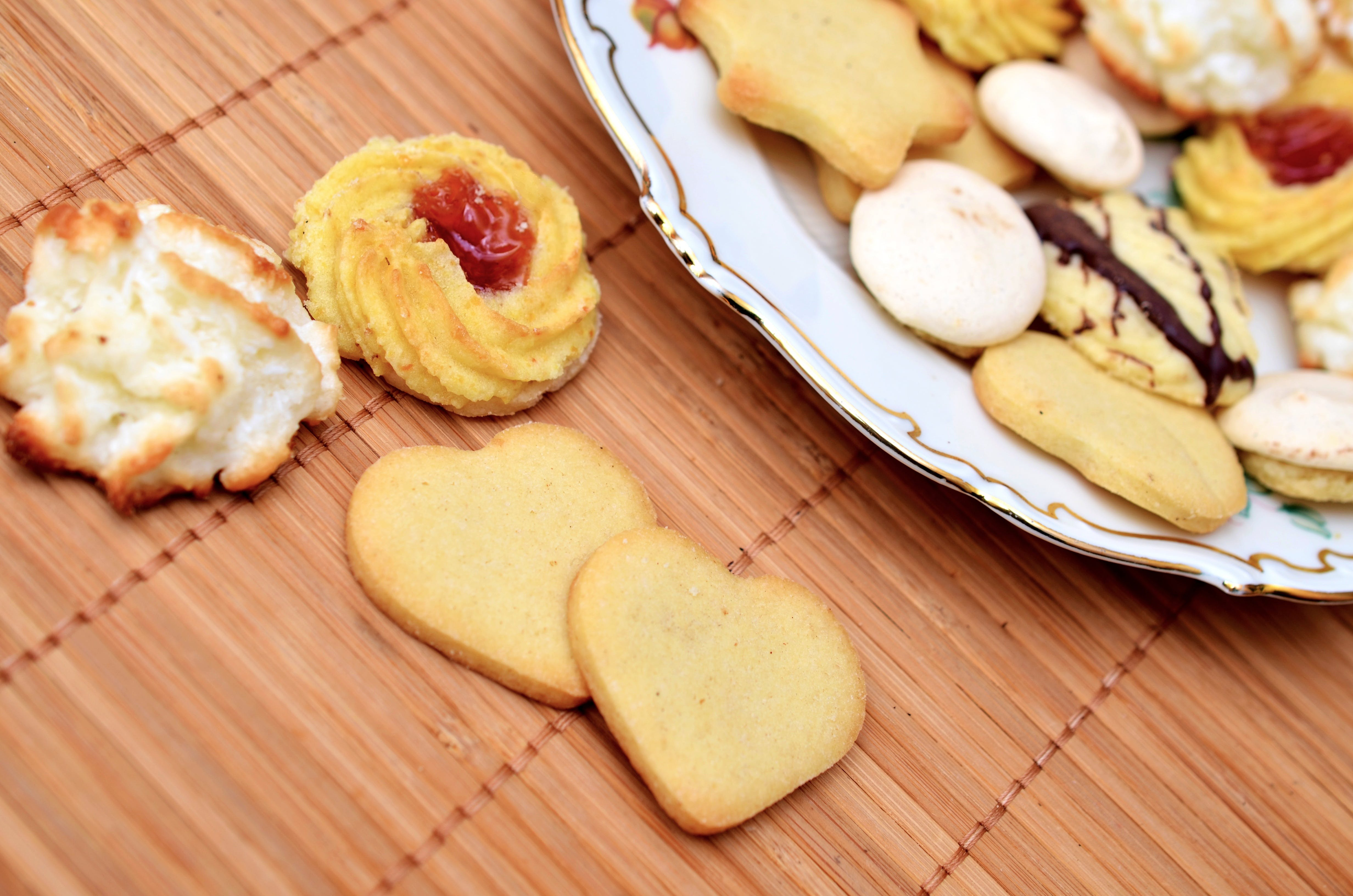 Assorted Baked Cookies on White Ceramic Plate on Top of Brown Bamboo Mat