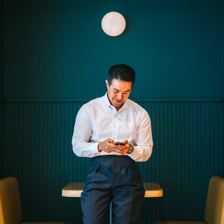 Man Holding Black Smartphone
