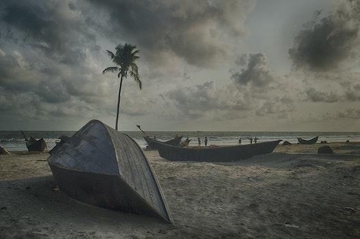 Gray Boat on Gray Sand Beach Under Gray Cloudy Sky