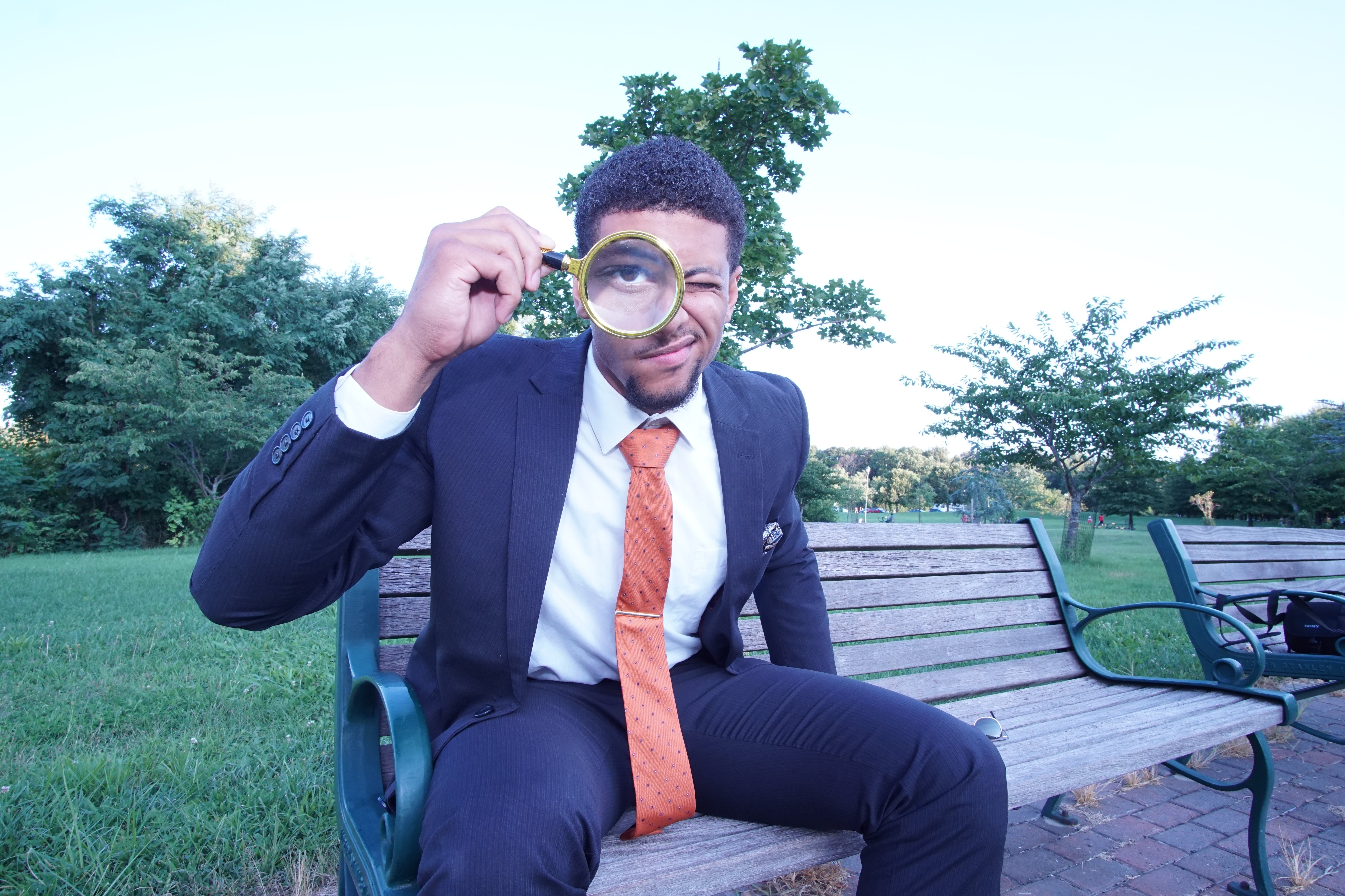 Free stock photo of suit, science, city park, magnifying glass