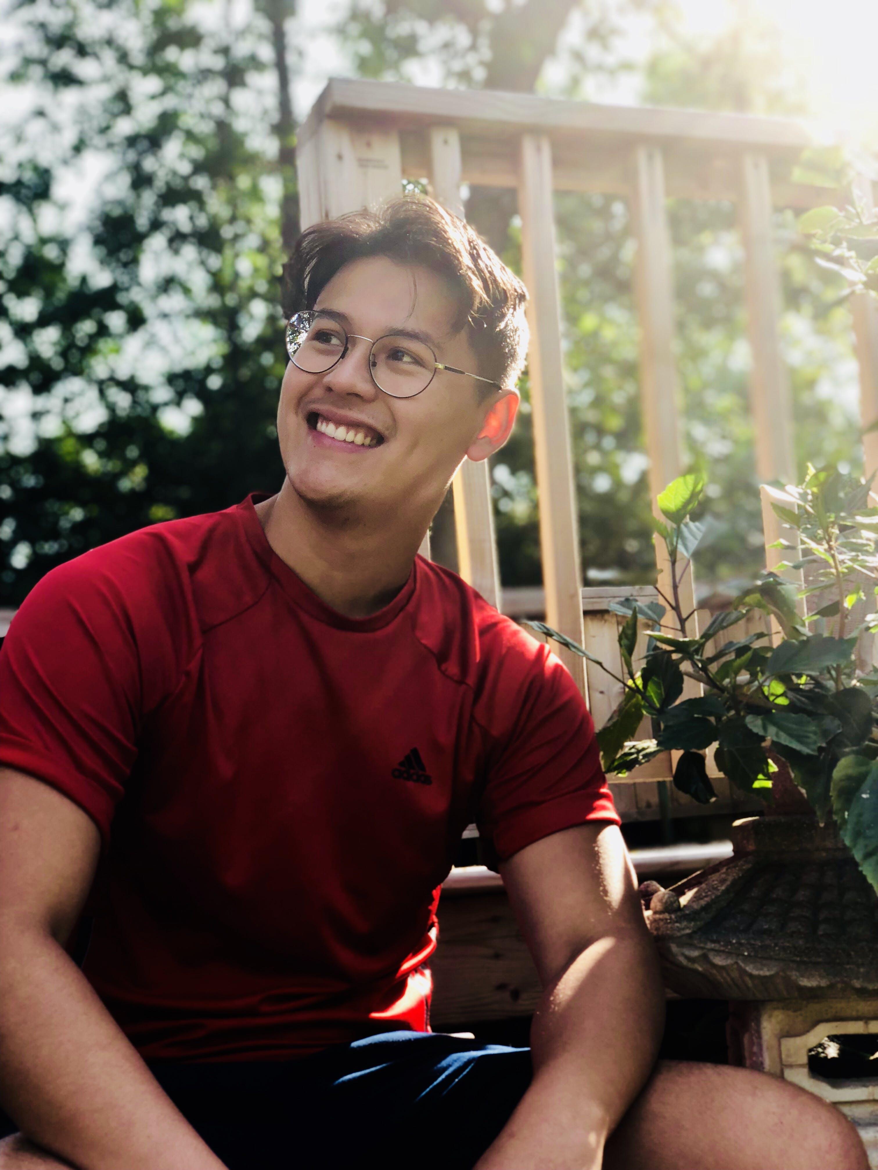 Man Wearing Red Shirt And Eyeglasses
