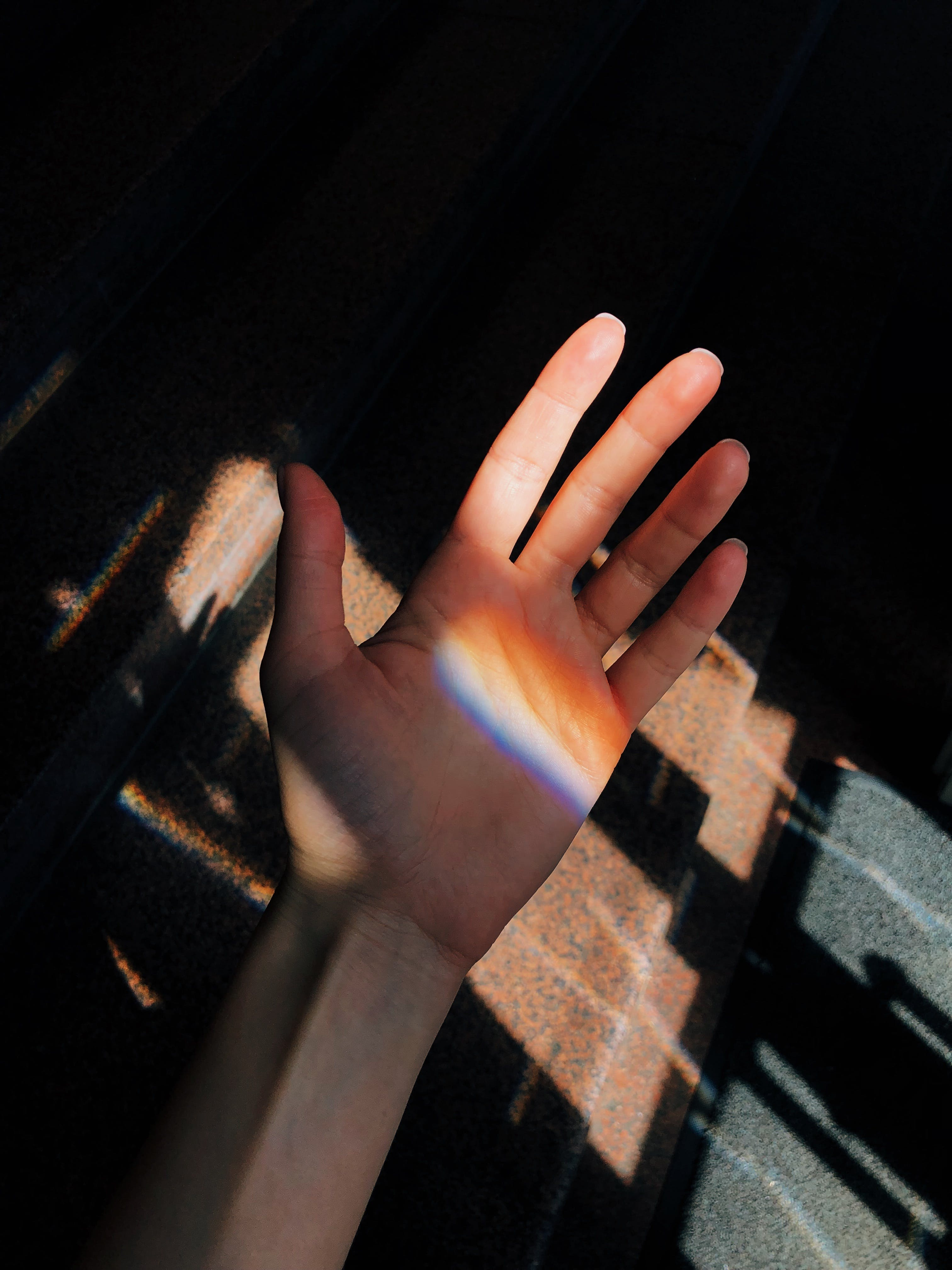 Left Person's Palm Near Brown Metal Panel