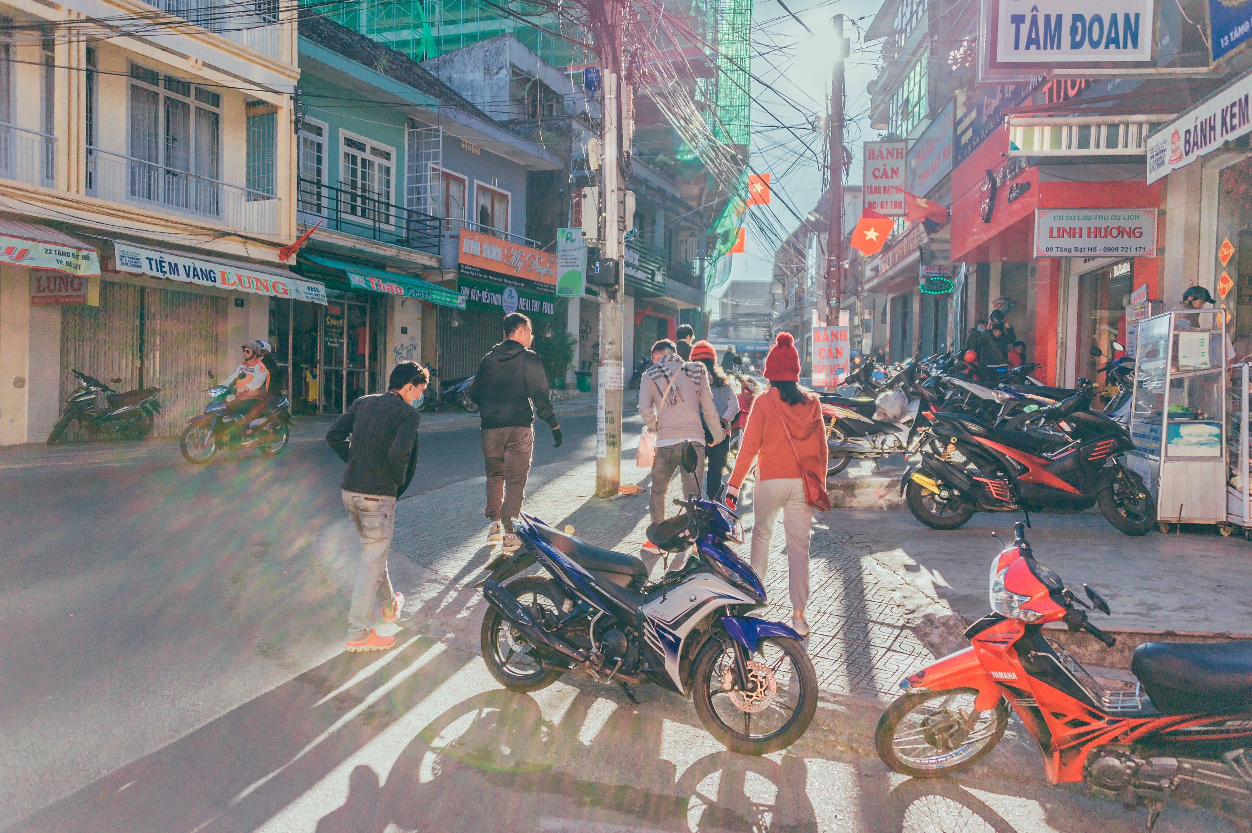 People Walking Near Motorcycles