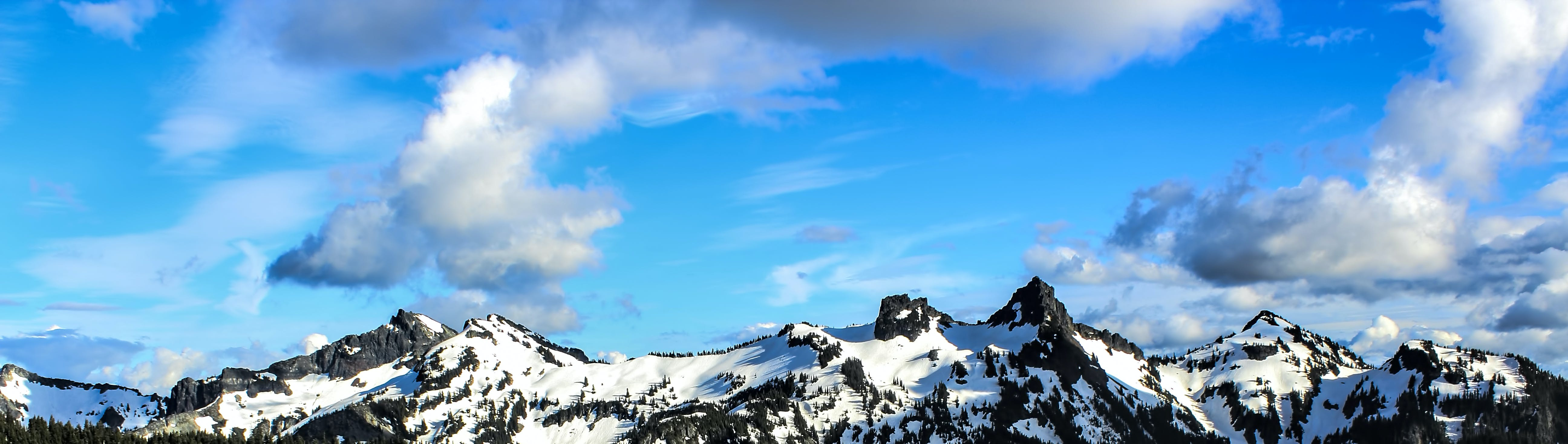 White and Black Snowy Mountain Under Blue Cloudy Sky