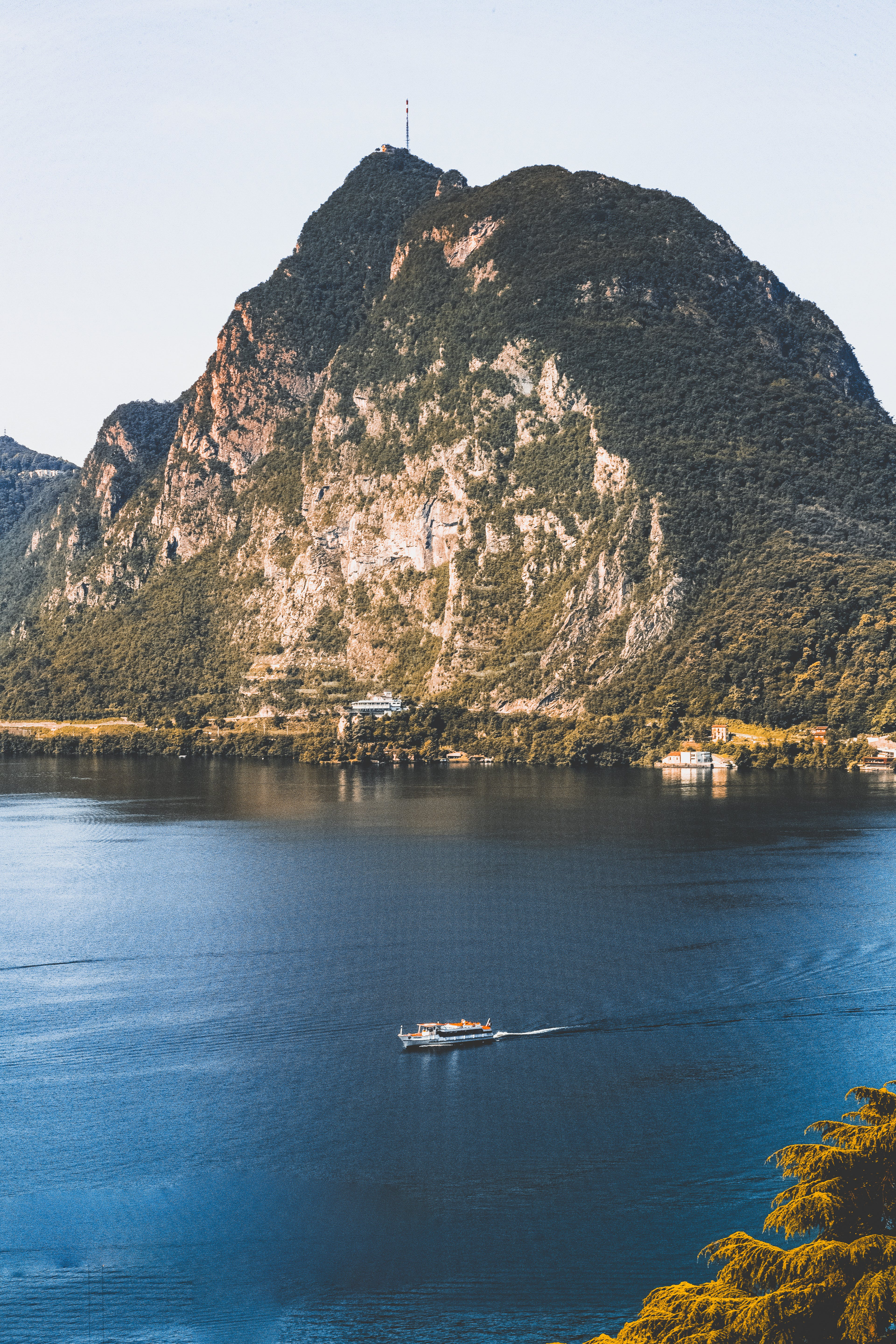 High Angled Photography Of Boat Near Mountain