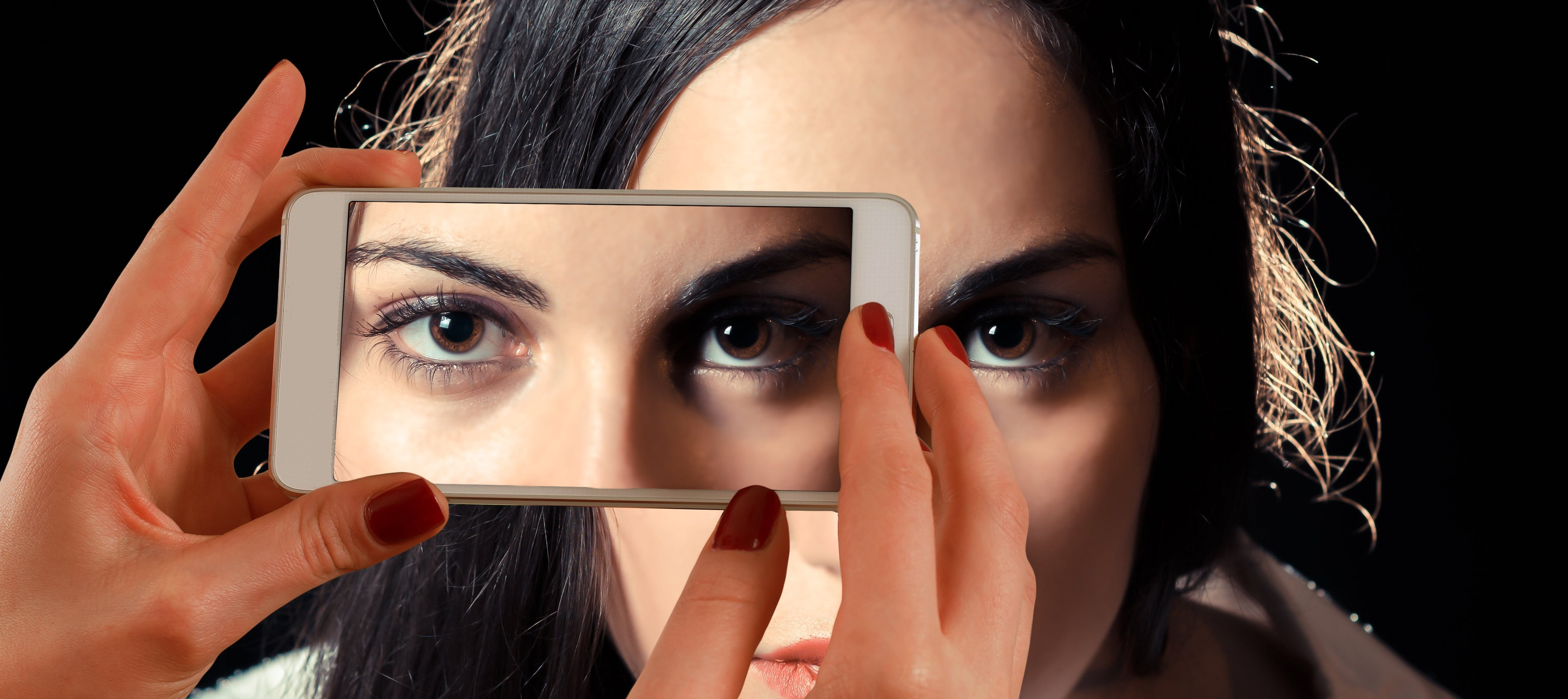 Eyebrow of Woman Taken Shot by White Smartphone Inside Well Lighted Room