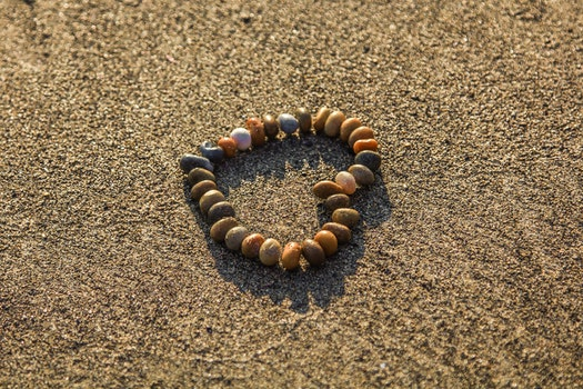 Brown and Grey Stone Formed Heart on Sand