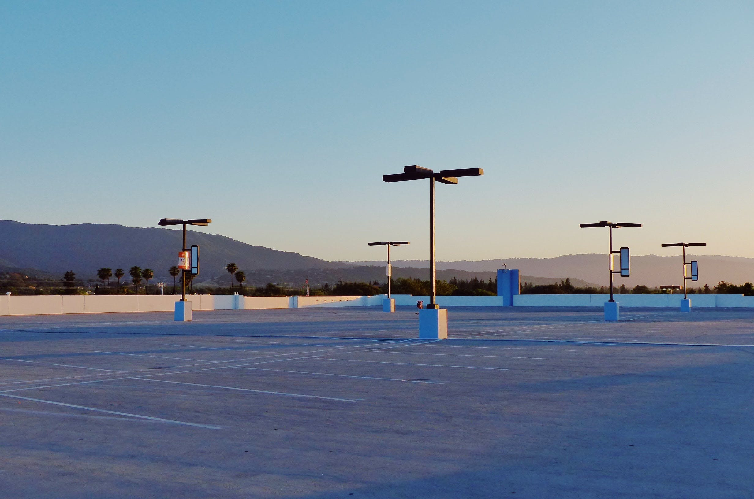 Free stock photo of lamps, lavender, minimalism, parking area
