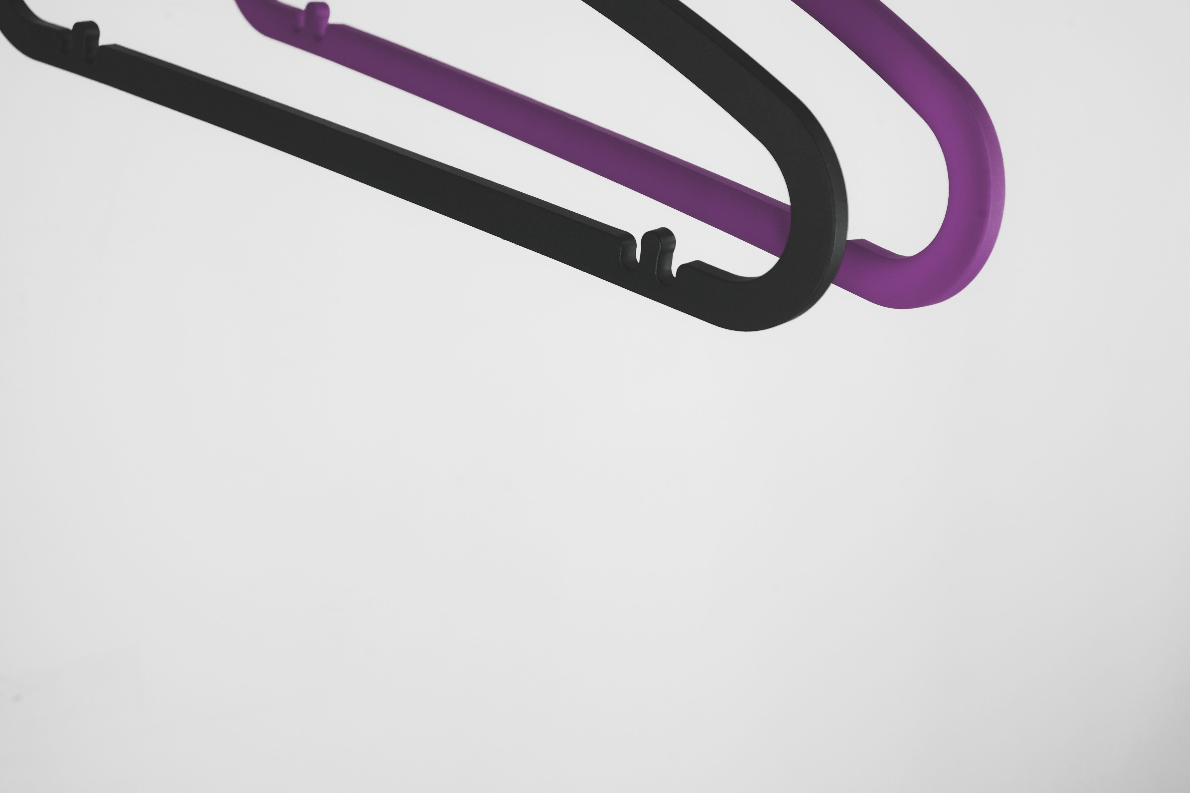 Black and Pink Plastic Clothes Hangers