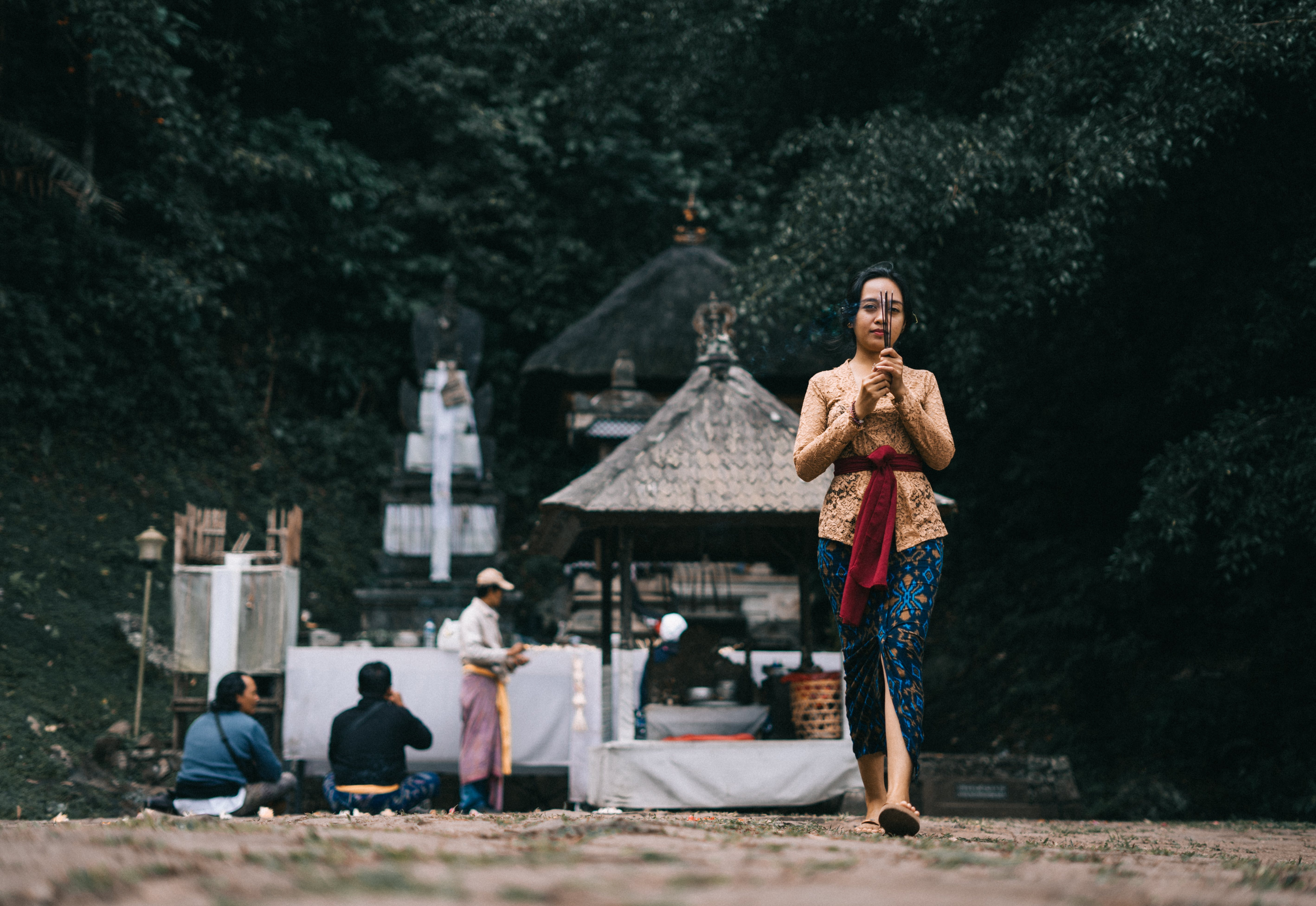 Woman In Brown And Blue Dress Holding Incense