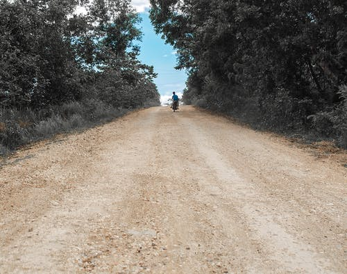 Free stock photo of bicycle, blue, dirt road, gray