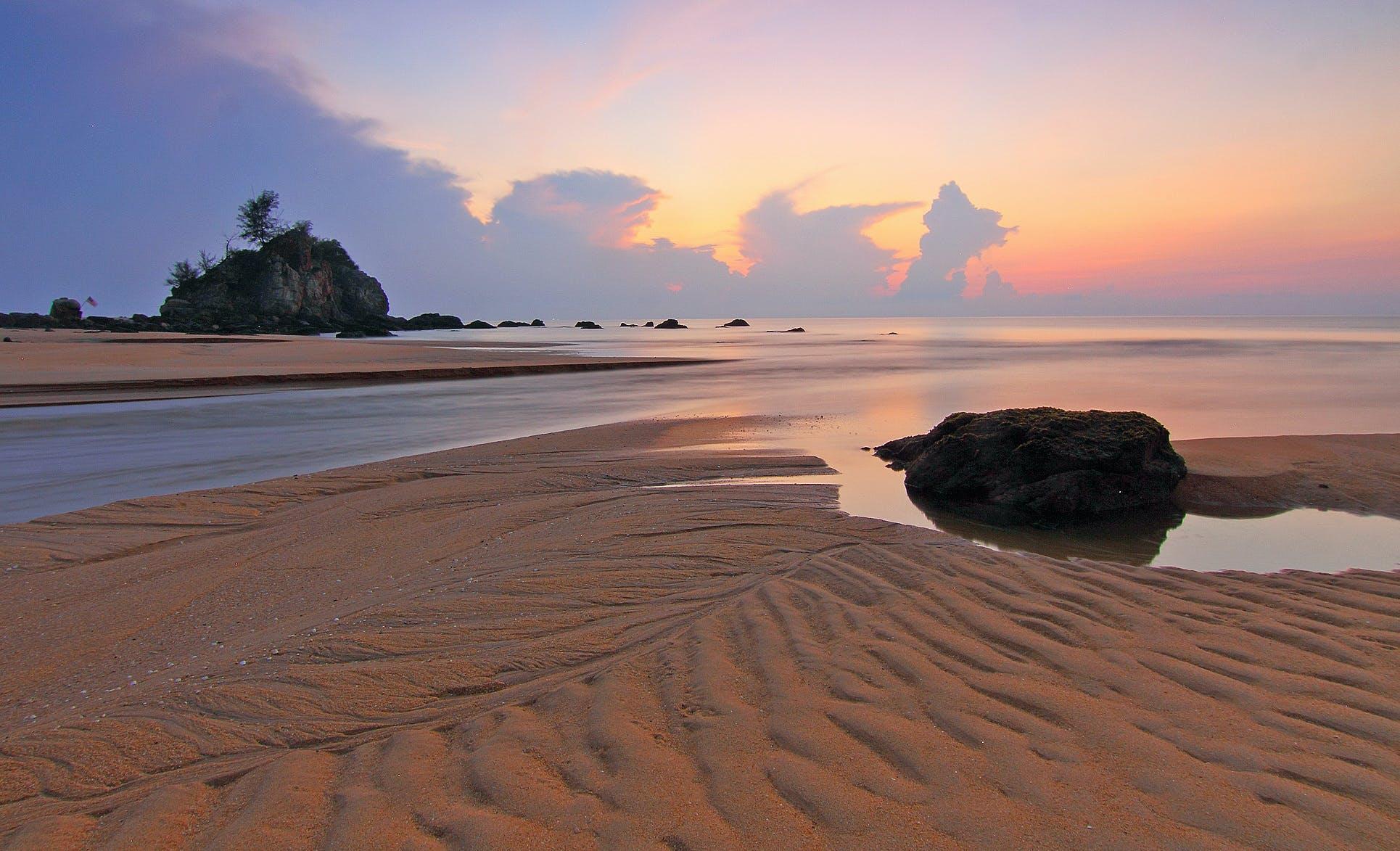 Gray Sand Near Body of Water