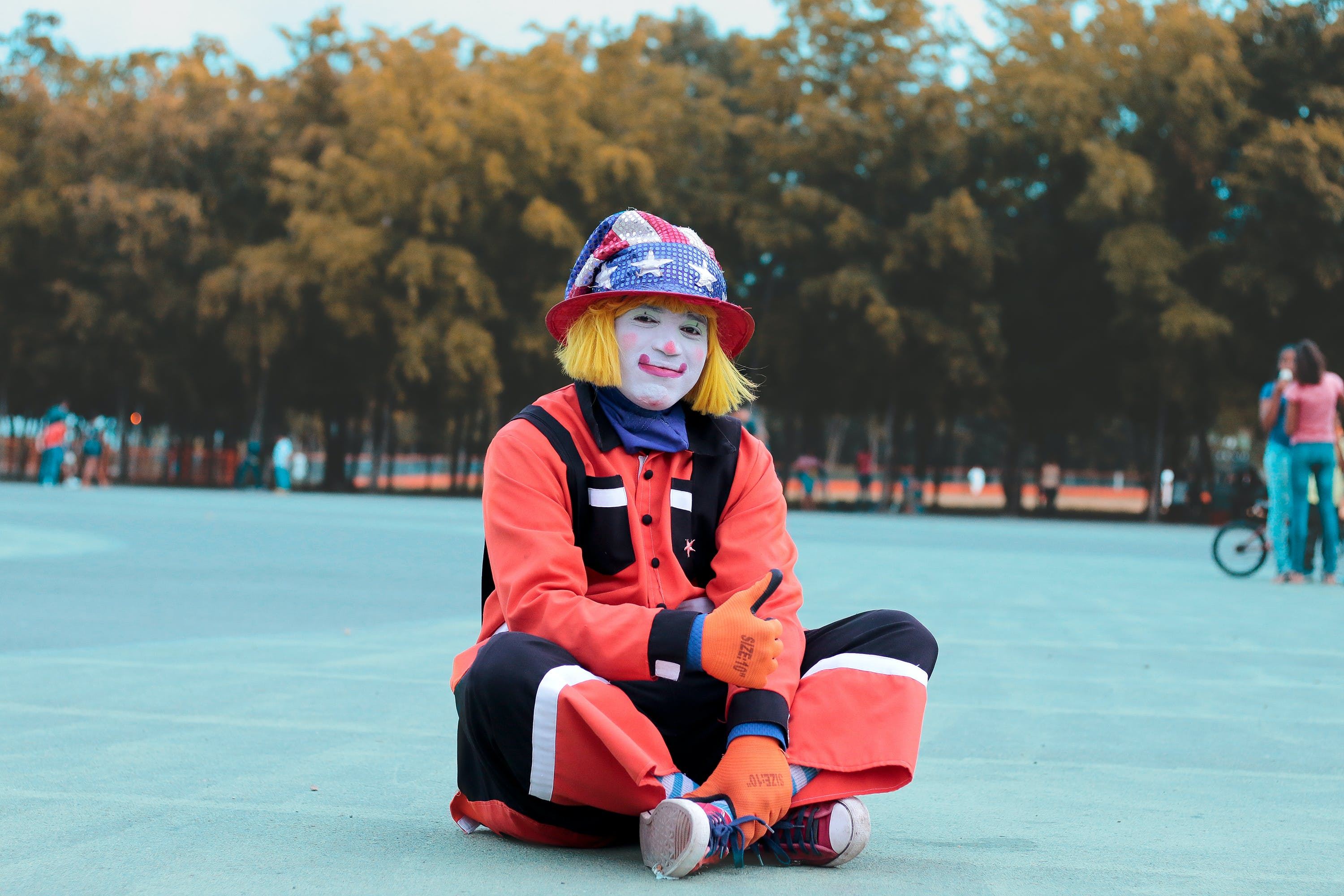 Low-angle of Clown Sitting on Ground