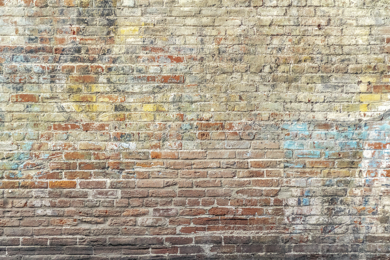 Kostenloses Stock Foto zu backsteinmauer, dreckig, graffiti, hintergrund