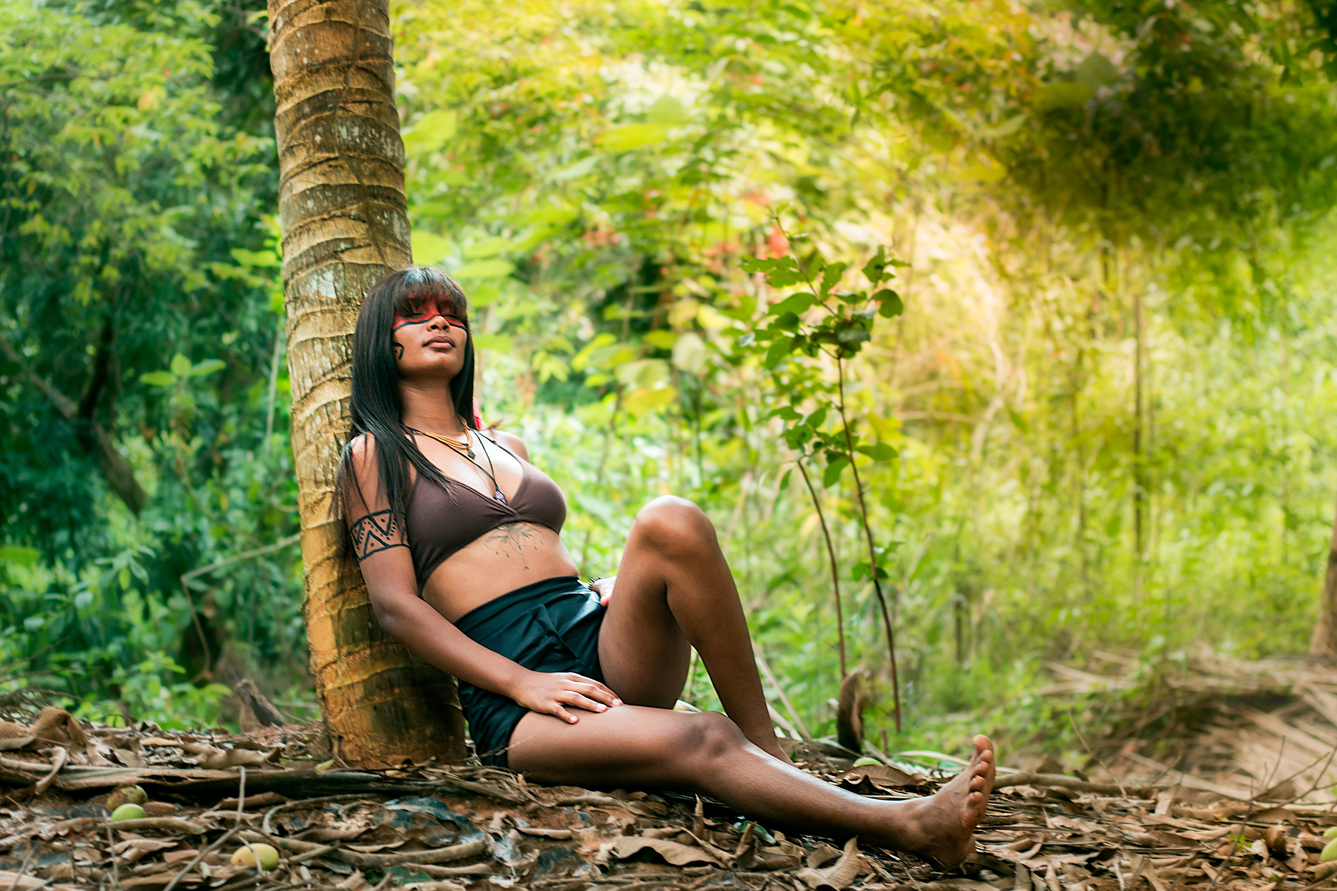 Woman Leaning on Tree Trunk