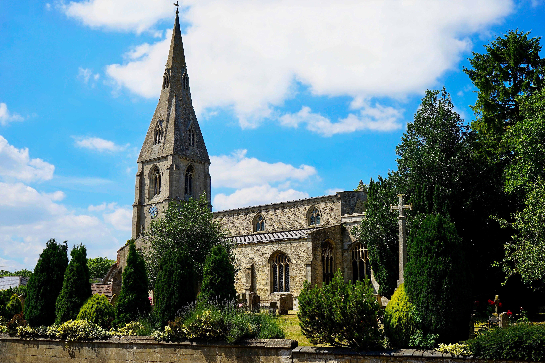 Free stock photo of village, trees, church, blue sky