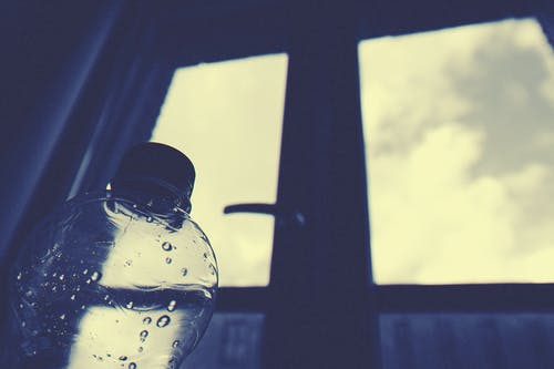 Clear Plastic Bottle Beside Window