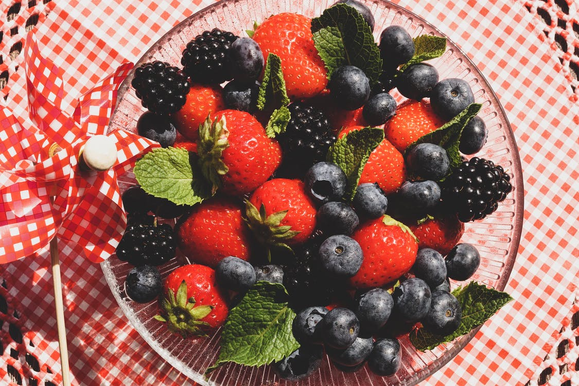 Strawberries and Blueberries on Glass Bowl