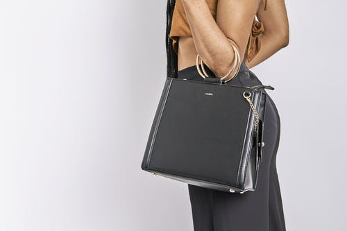 Woman Carrying Black Leather Bag