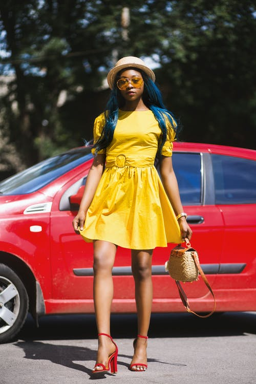 Woman Wearing Yellow Boat-neck Short-sleeved Dress Standing Near Red Car