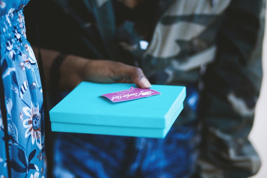 Person Holding Blue Box