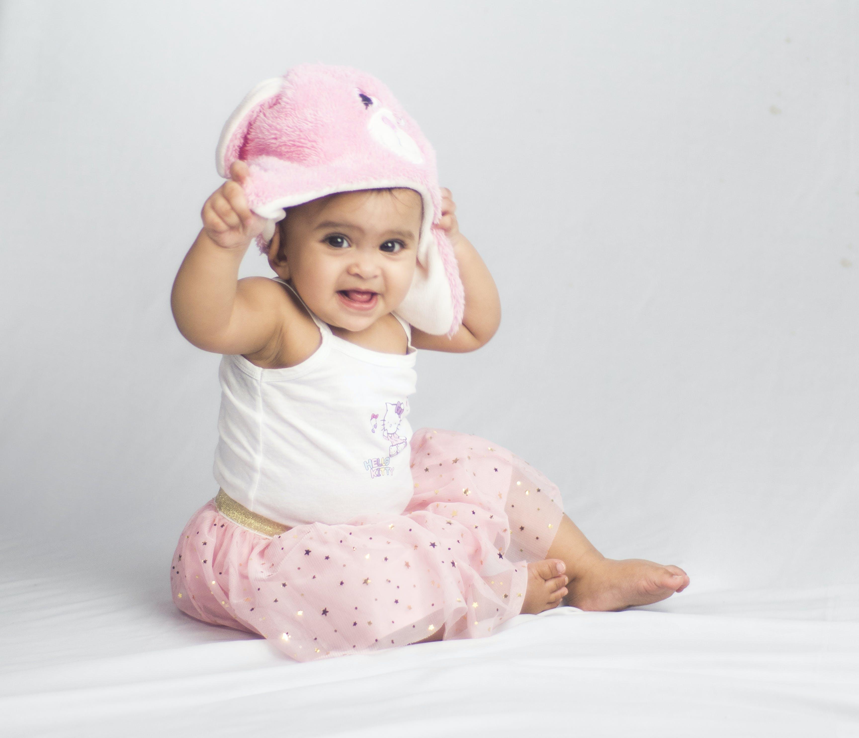 Foto profissional grátis de bebê, bebês, fofinha, fundo branco