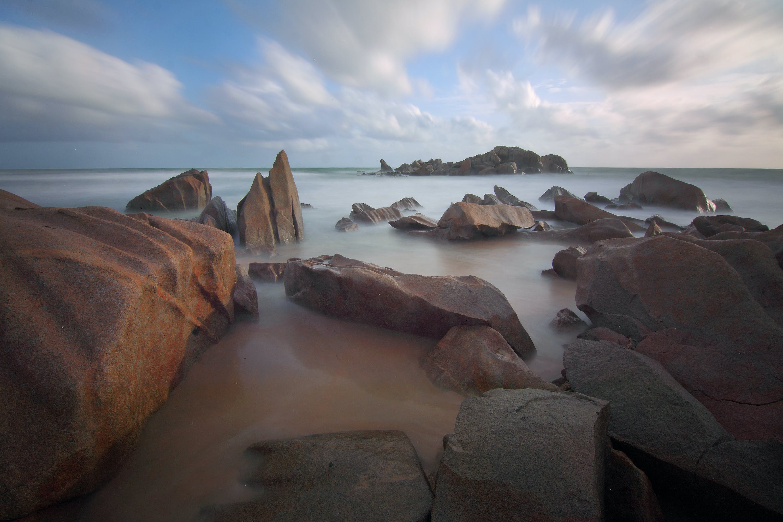 Rocks in Sea during Daytime