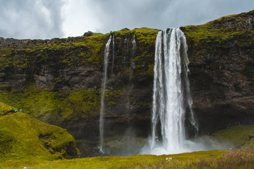 Photo of Waterfalls during Cloudy Sky