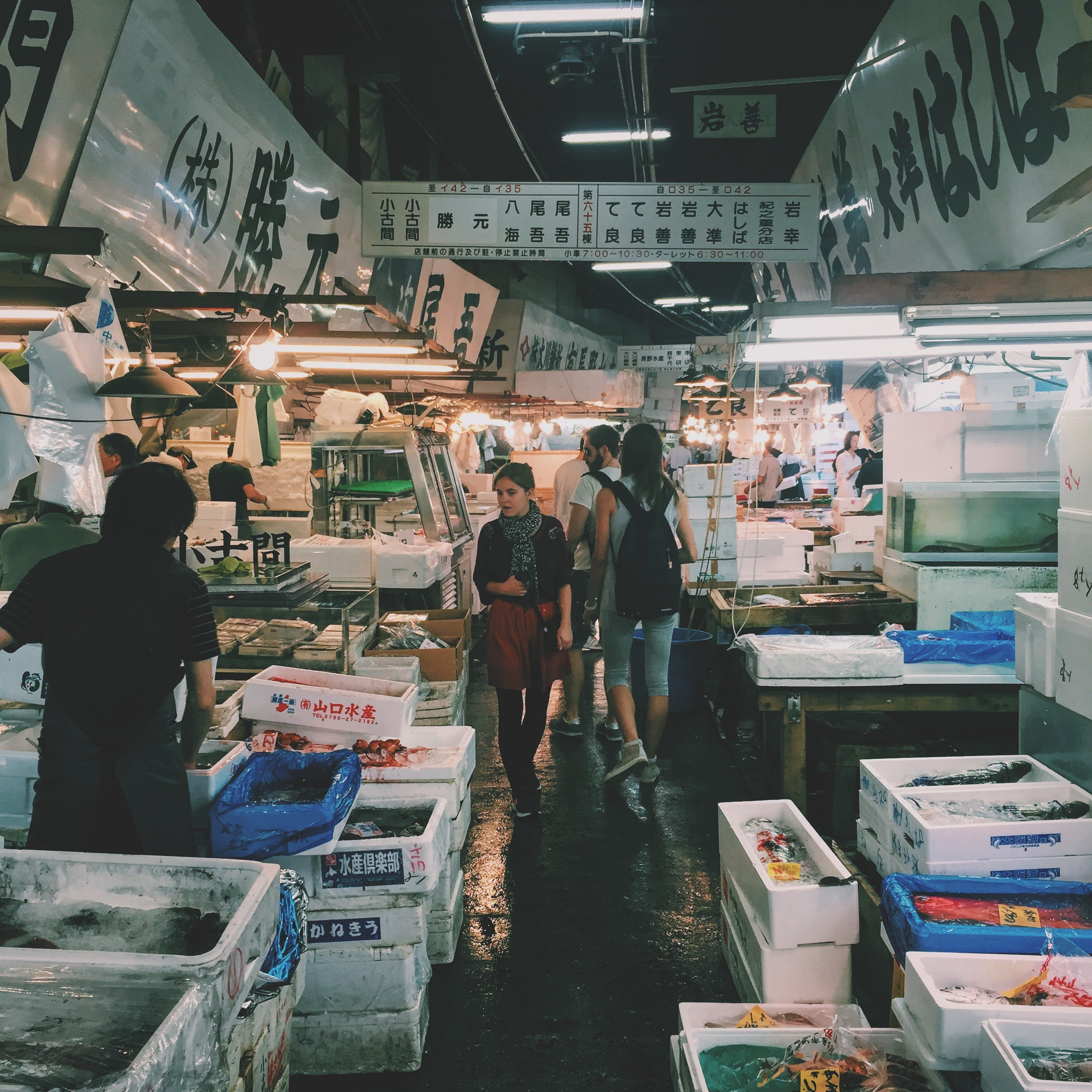 Person Waling on Market in Meat and Fish Section