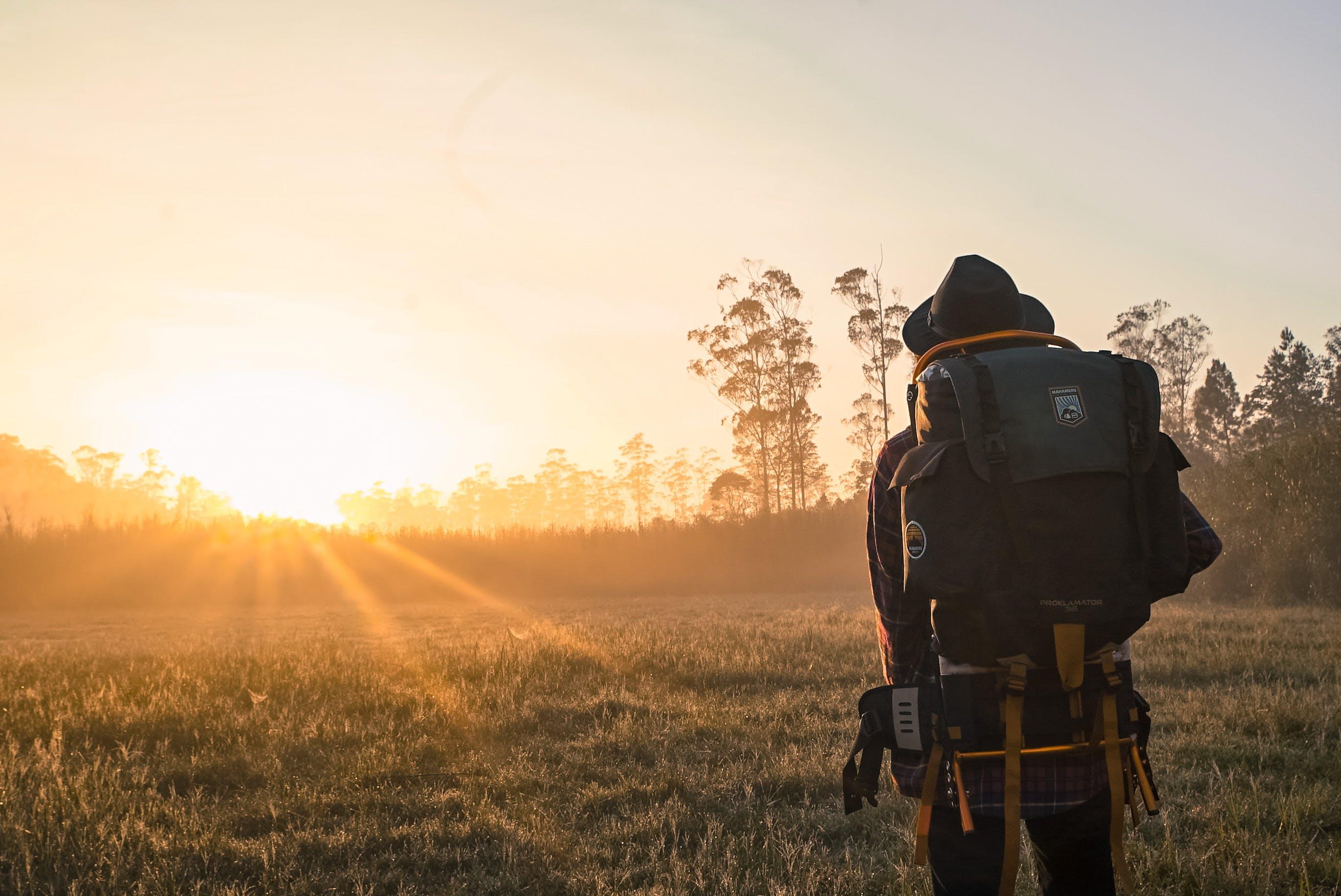 Man in Black Backpack during Golden Hour