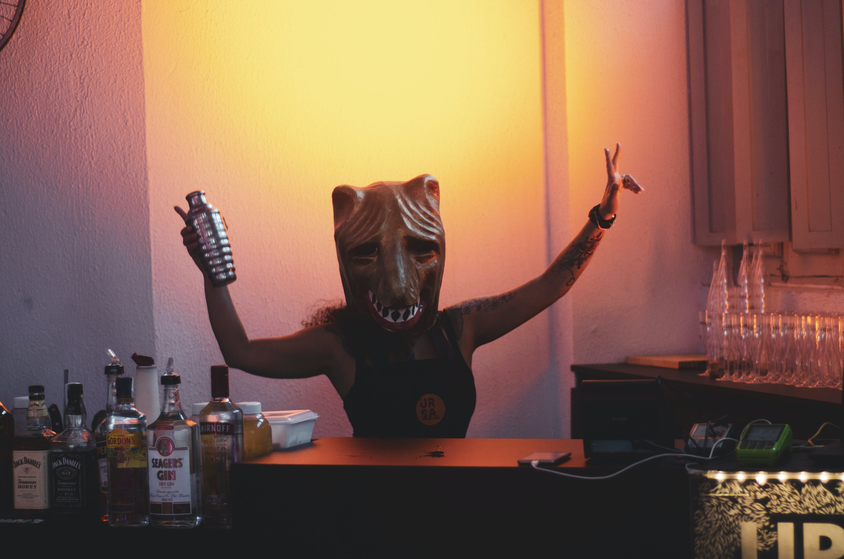 Person Wearing Mask Holding Cocktail Shaker