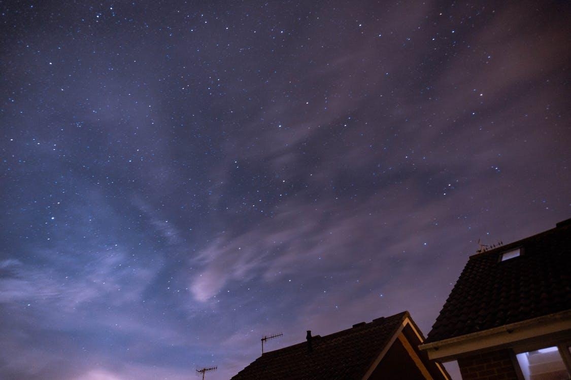 Grey Roofs Under Blue Starry Sky