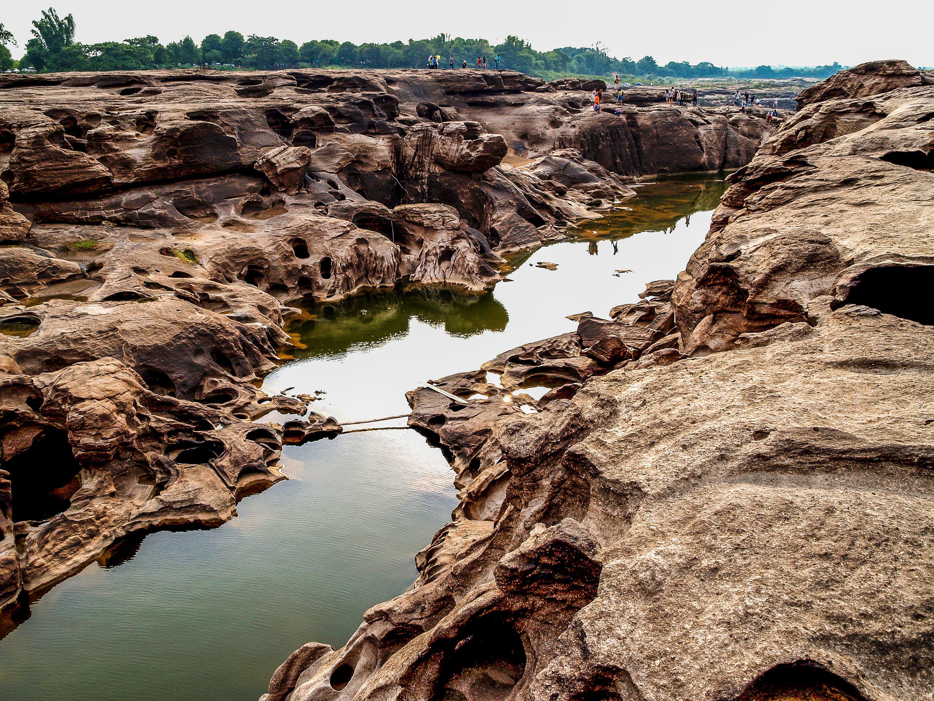 Body of Water in Between Rock Formation
