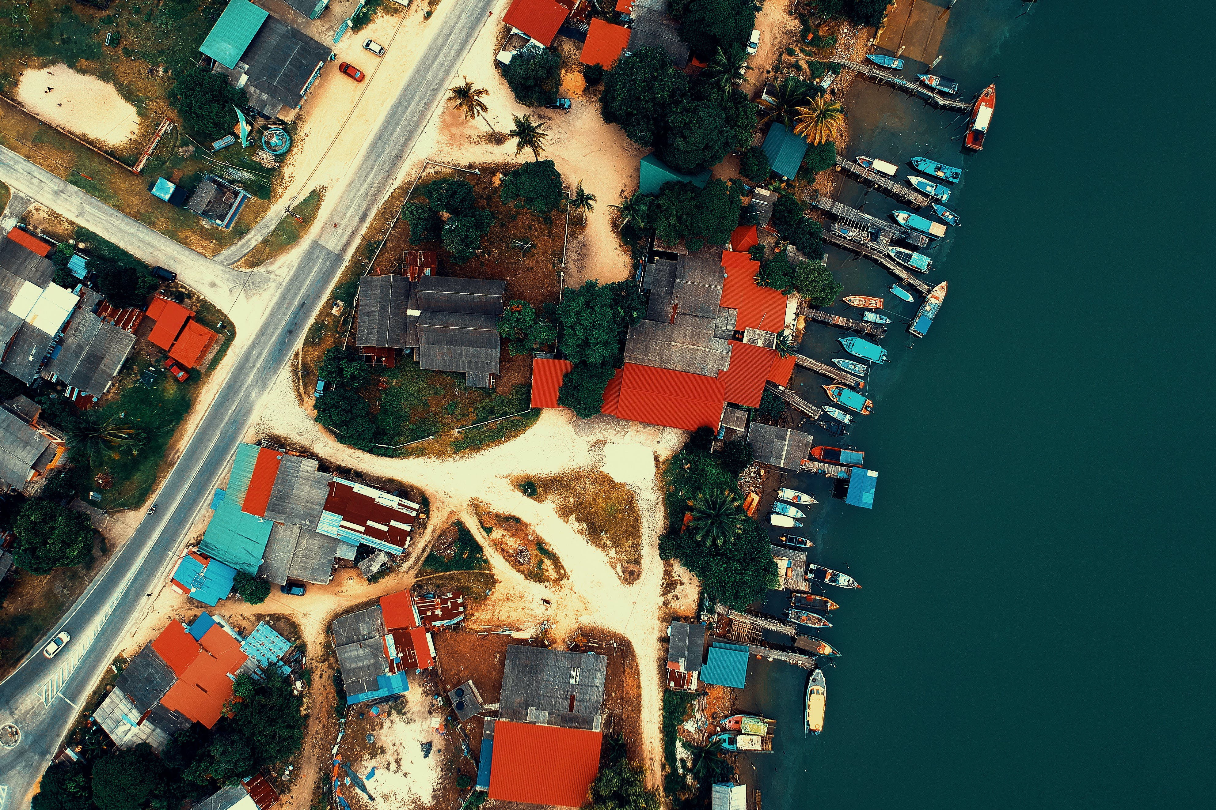 Aerial View of Buildings and Roads Near Sea