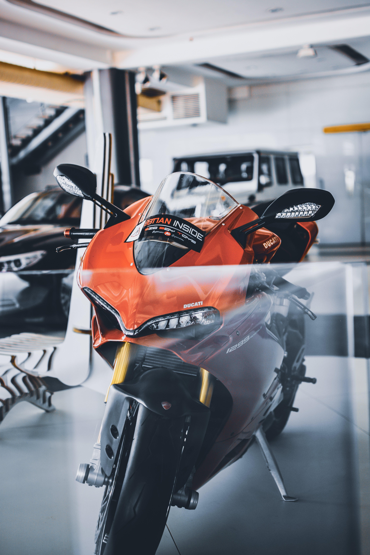 Red and Black Sports Bike Parking Inside Garage
