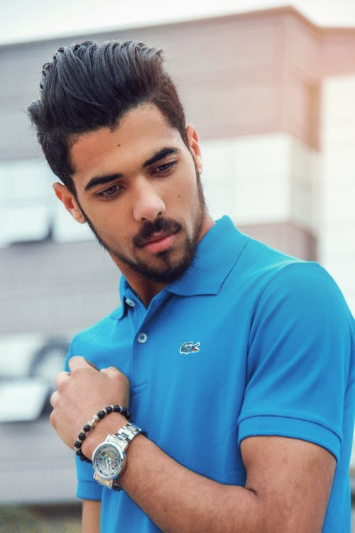 Man Wearing Blue Lacoste Polo Shirt and Silver-colored Analog Watch