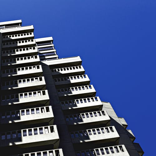 Gray High-rise Building Under Blue Sky