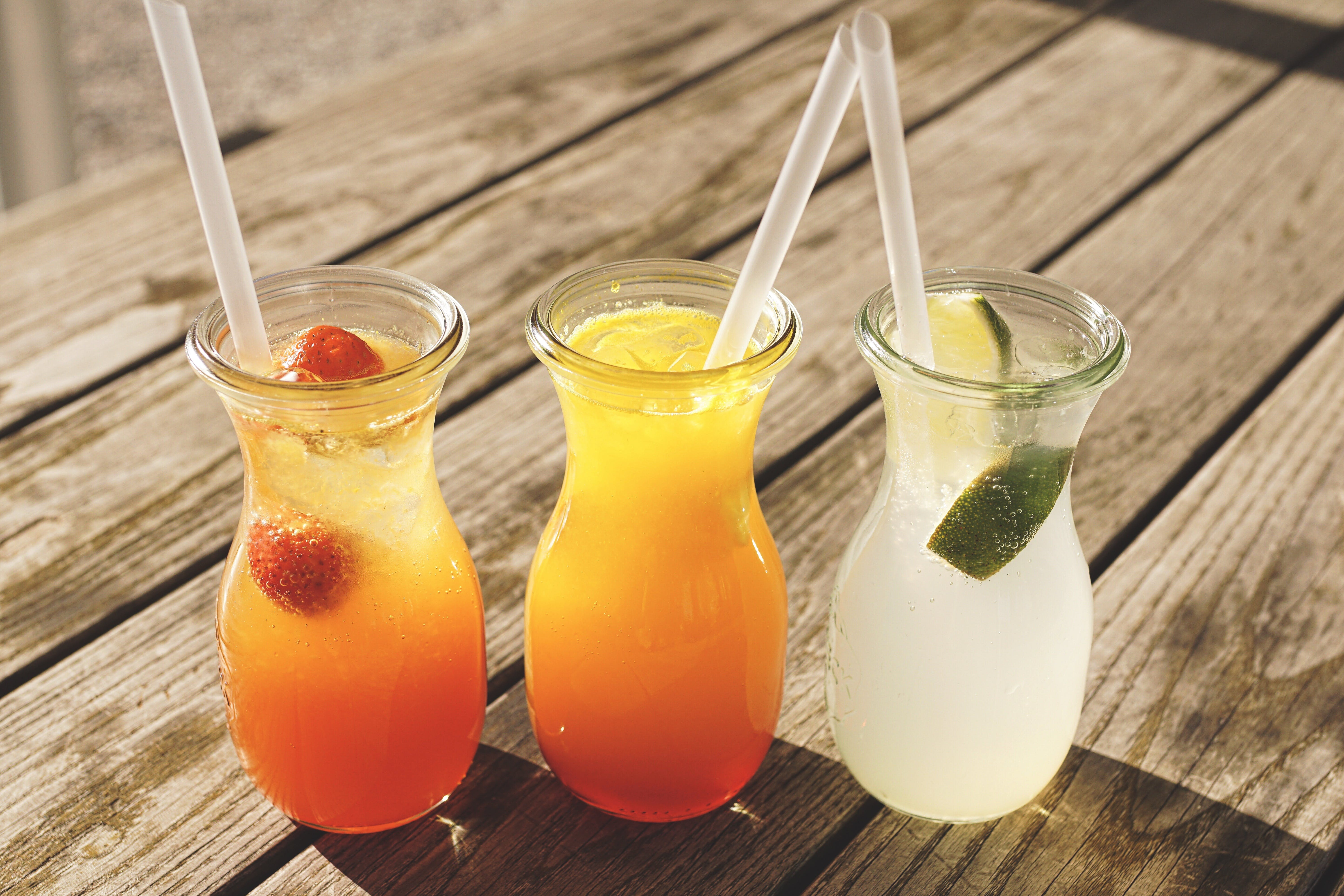 Three Assorted Fruit Juice in Glasses