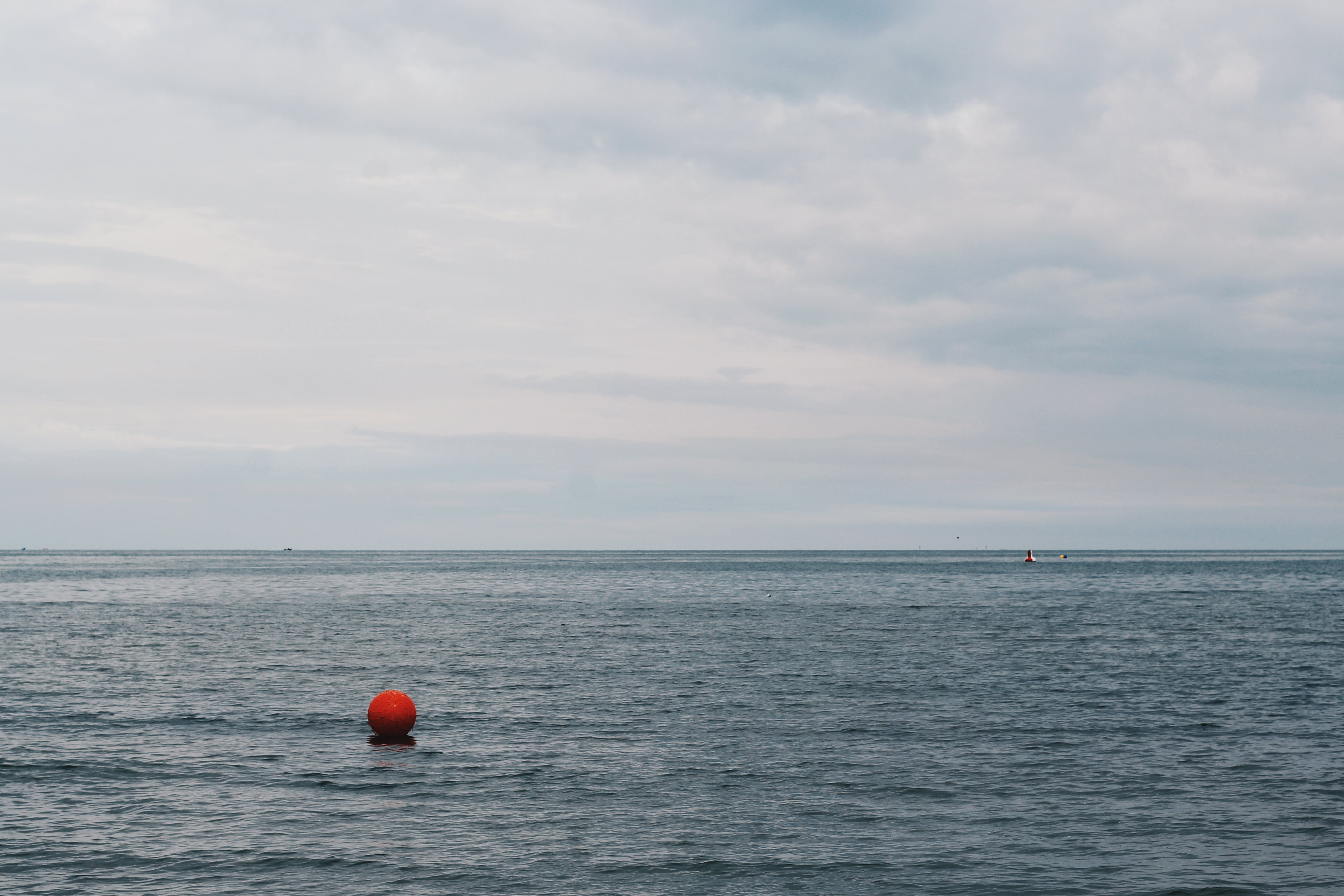 Red Buoy Floating on Body of Water