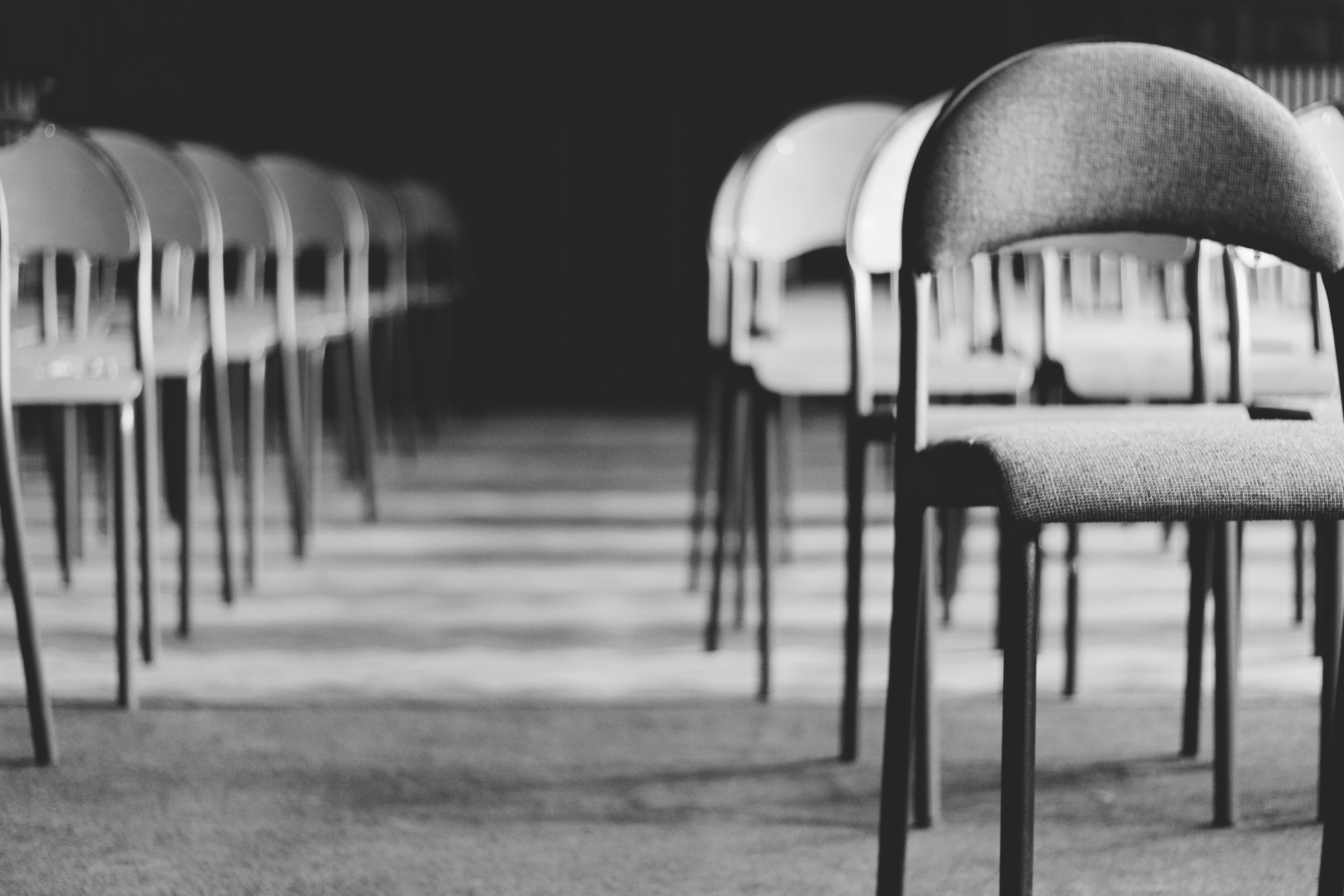 Grayscale Photo of Empty Folding Chairs