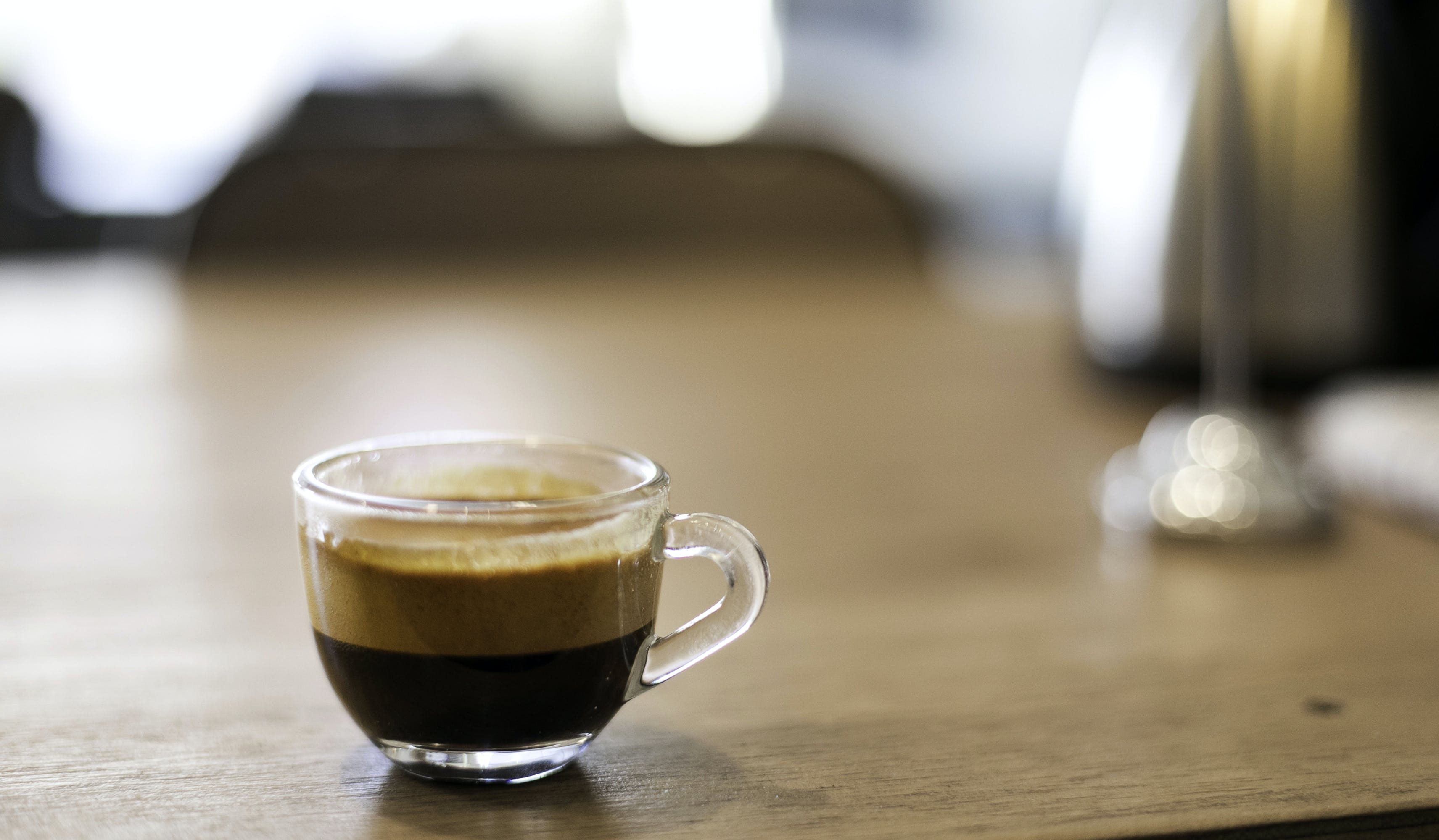 Selective Focus Photography of a Cup of Black Coffee