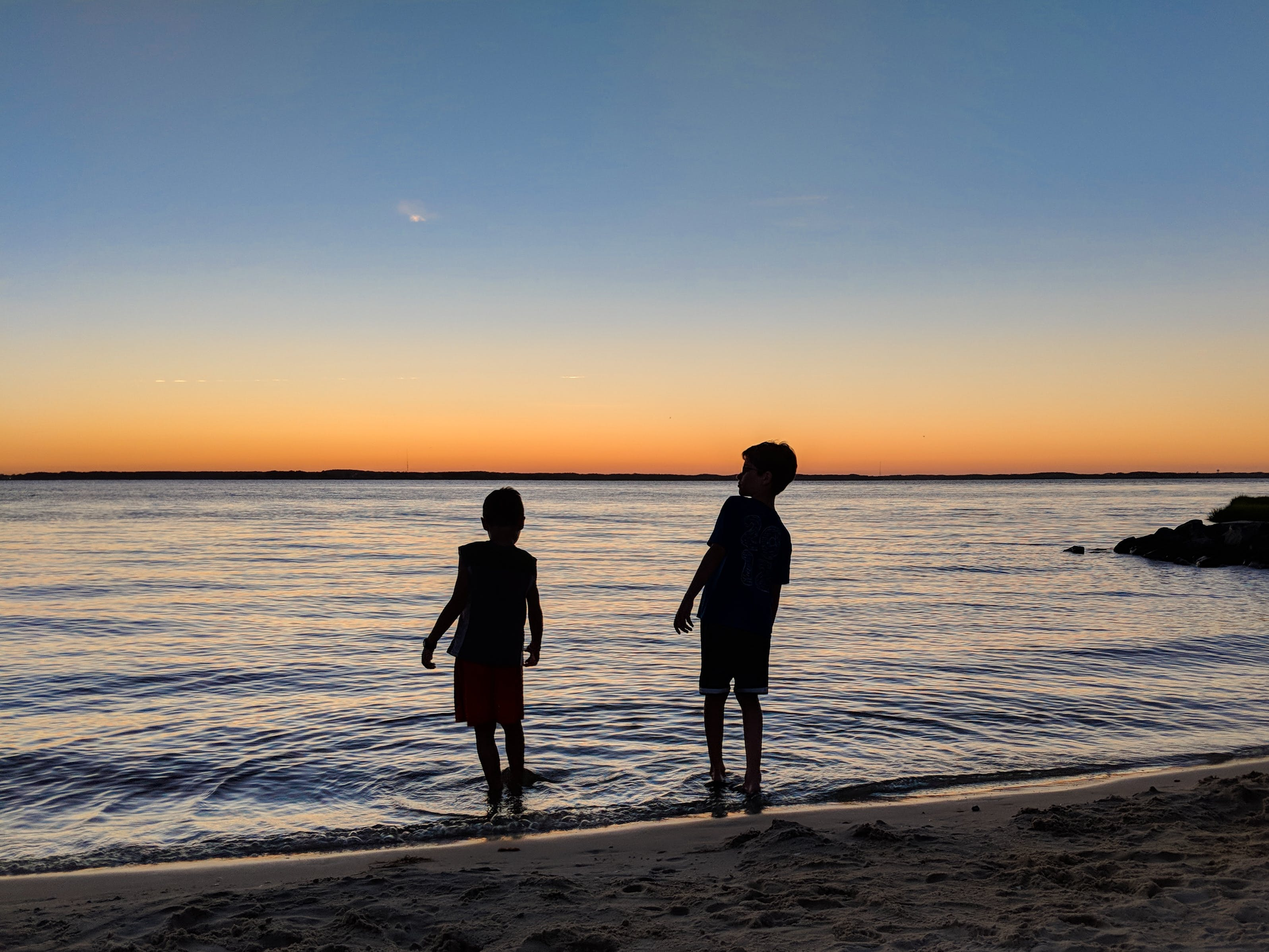 brothers, skipping rocks, sunset