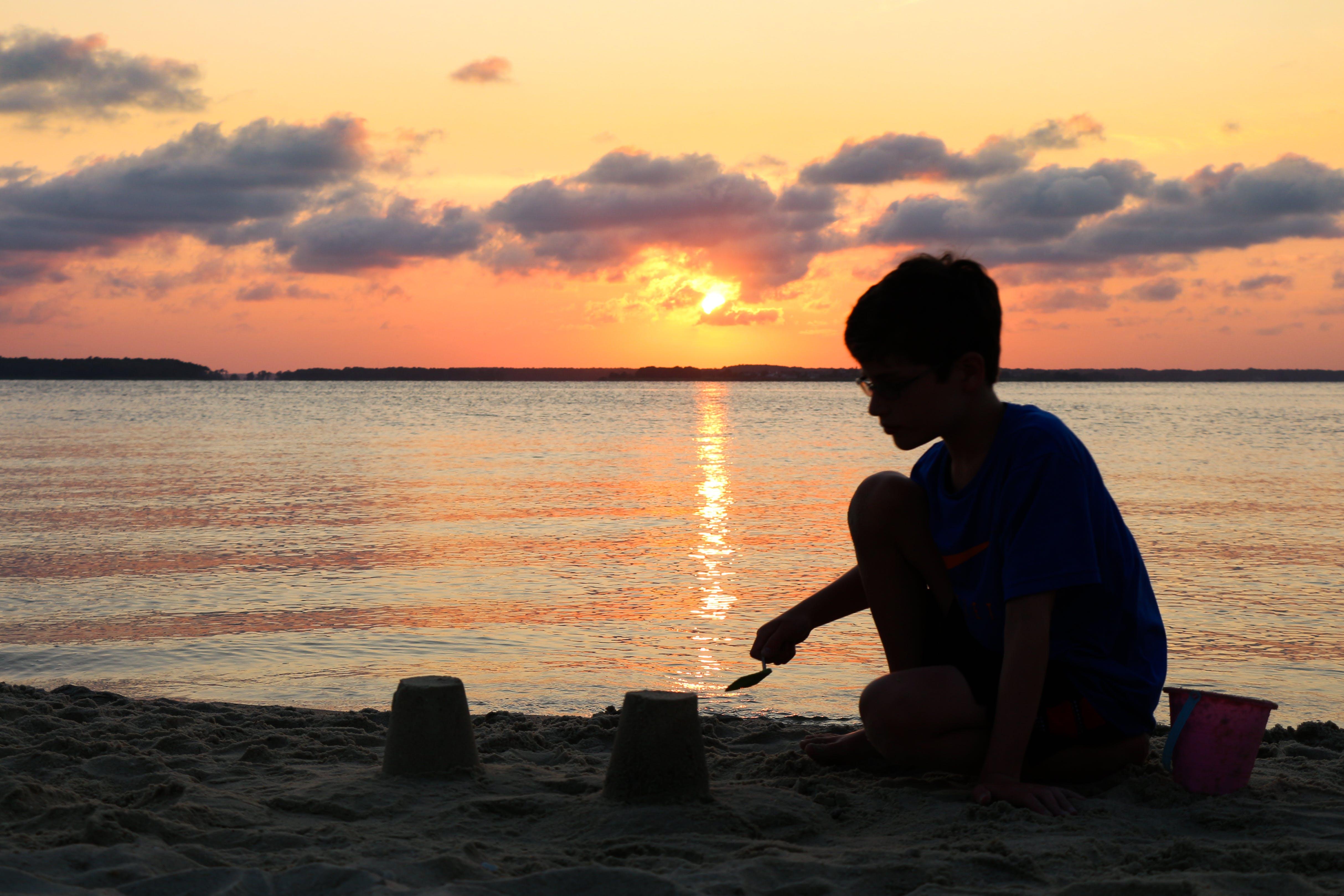 Fotobanka sbezplatnými fotkami na tému hrad z piesku, piesok, pláž, západ slnka