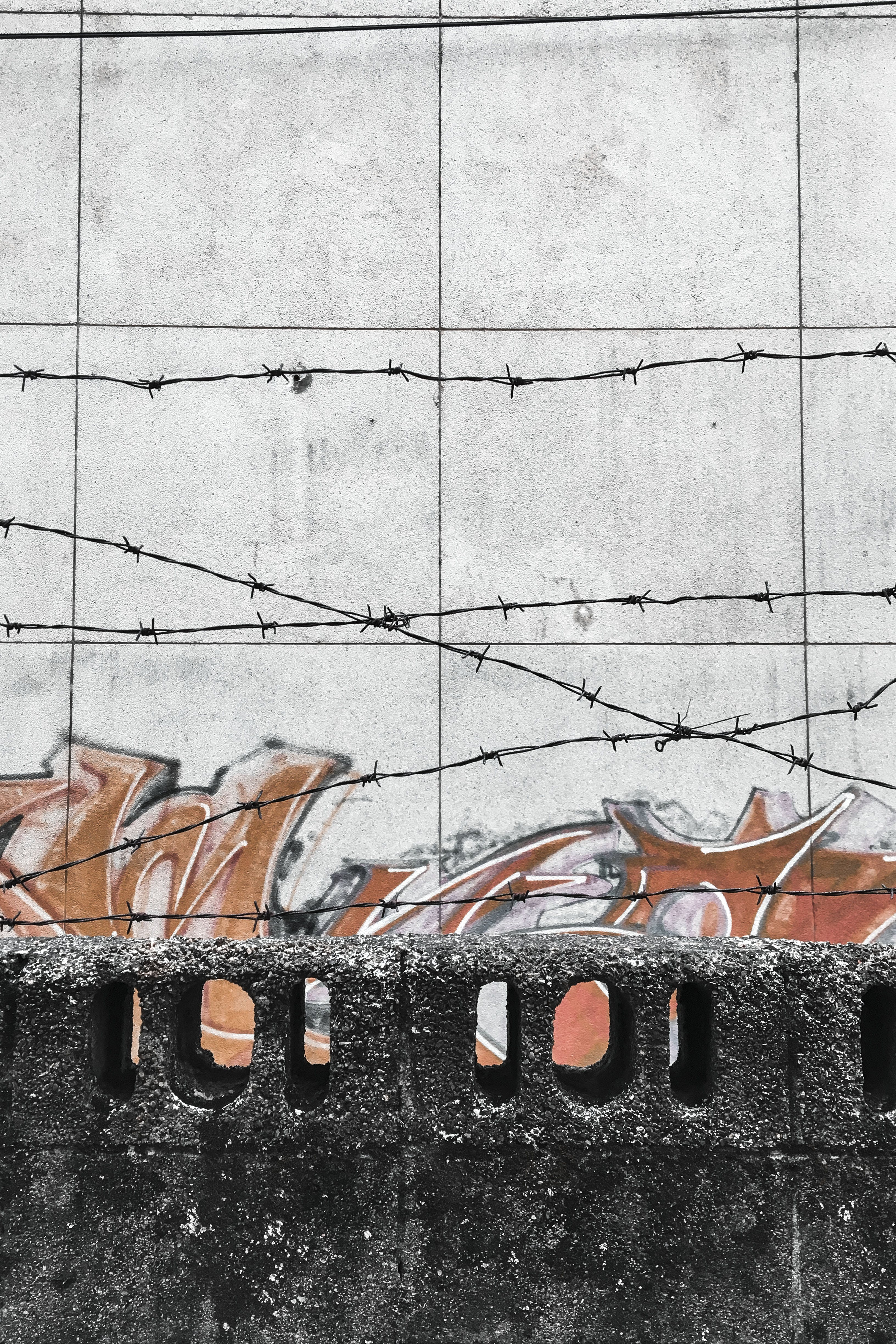 Barbed Wires Behind Concrete Wall